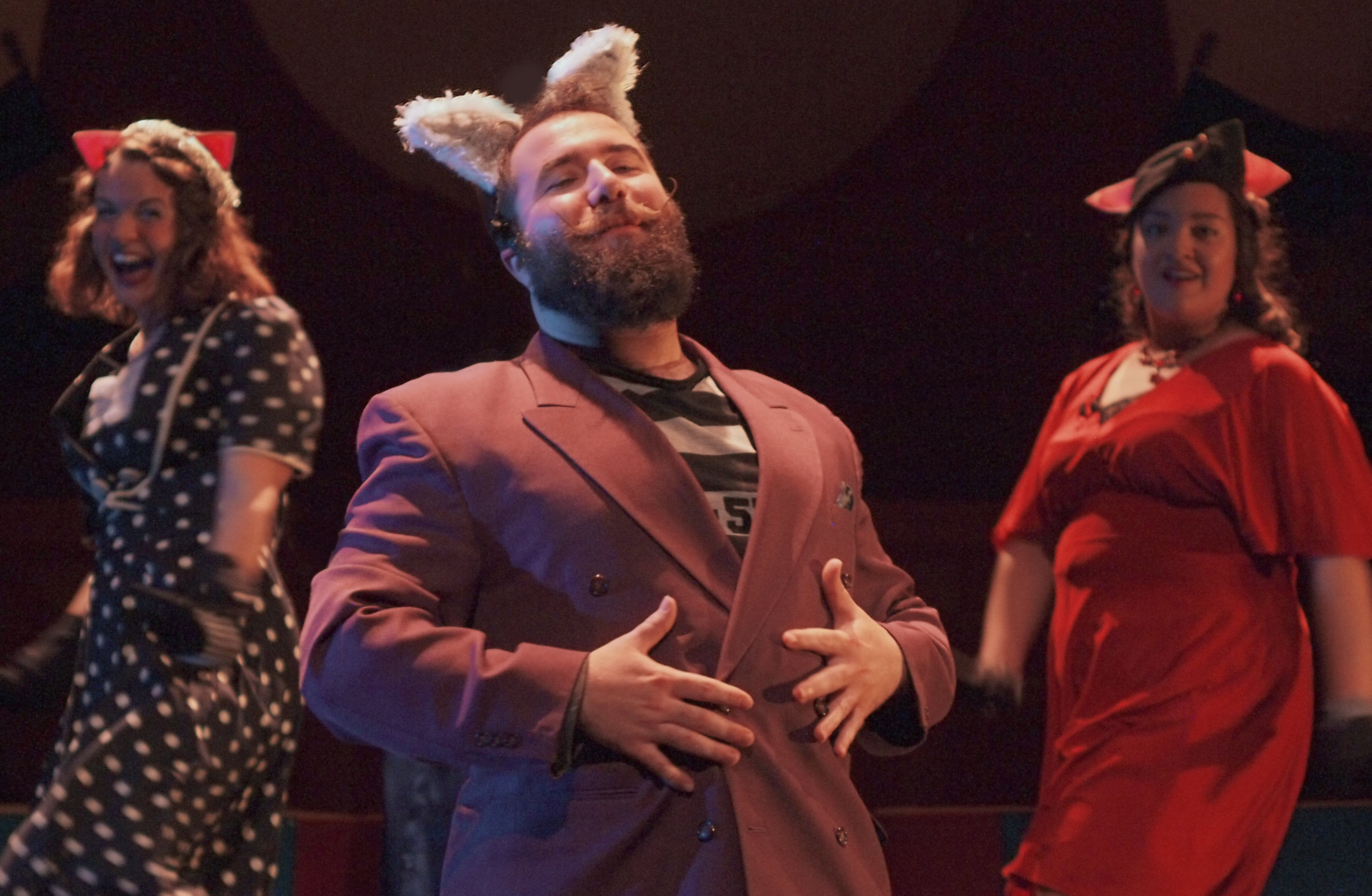 """Jacob Albarella is the Wolf and Sarah Blewett and Jennel Pruneda as Piggie Backup Singers in TOY's """"The True Story of the 3 Little Pigs."""""""