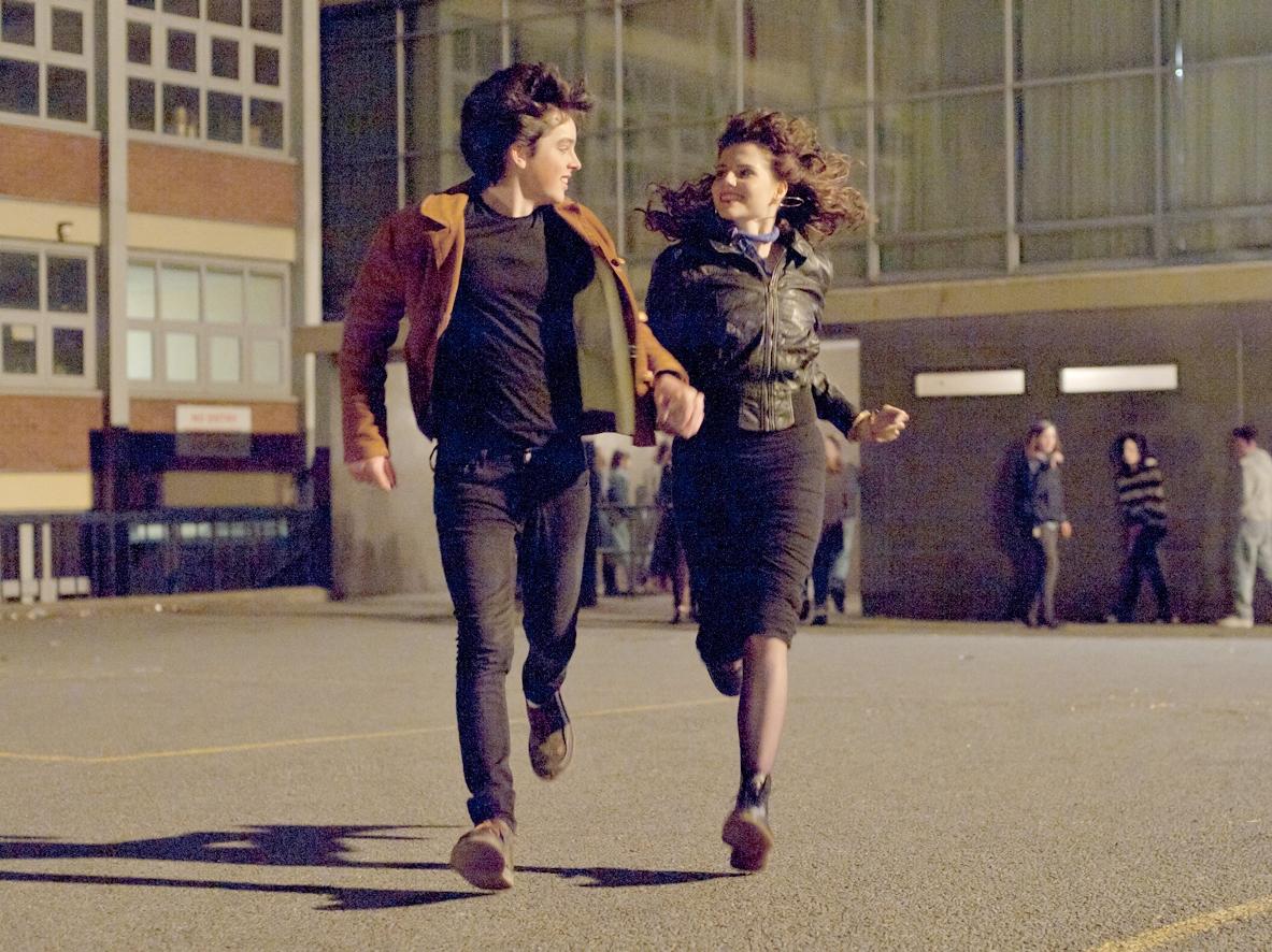 "Ferdia Walsh-Peelo and Lucy Boynton star in ""Sing Street."""