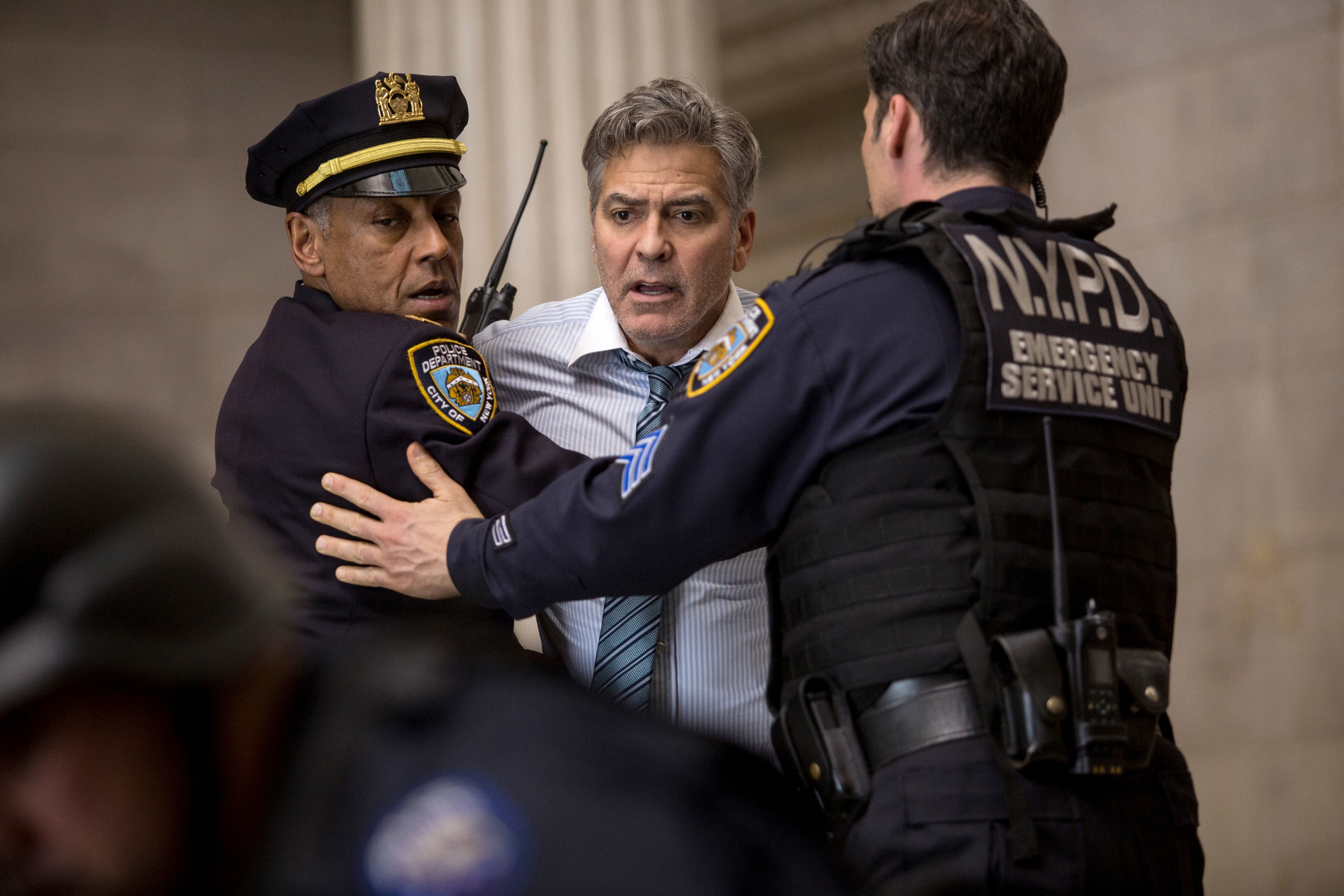 "Giancarlo Esposito, left, and George Clooney, center, star in ""Money Monster,"" which is directed by Jodie Foster."