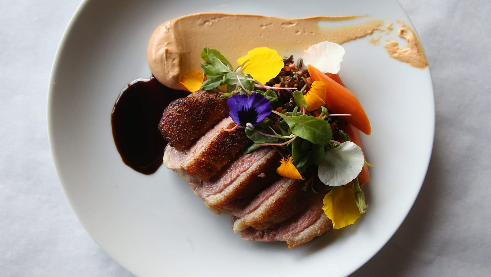 Crispy-skinned duck breast served with wild rice and ponzu. (Sharon Cantillon/Buffalo News)