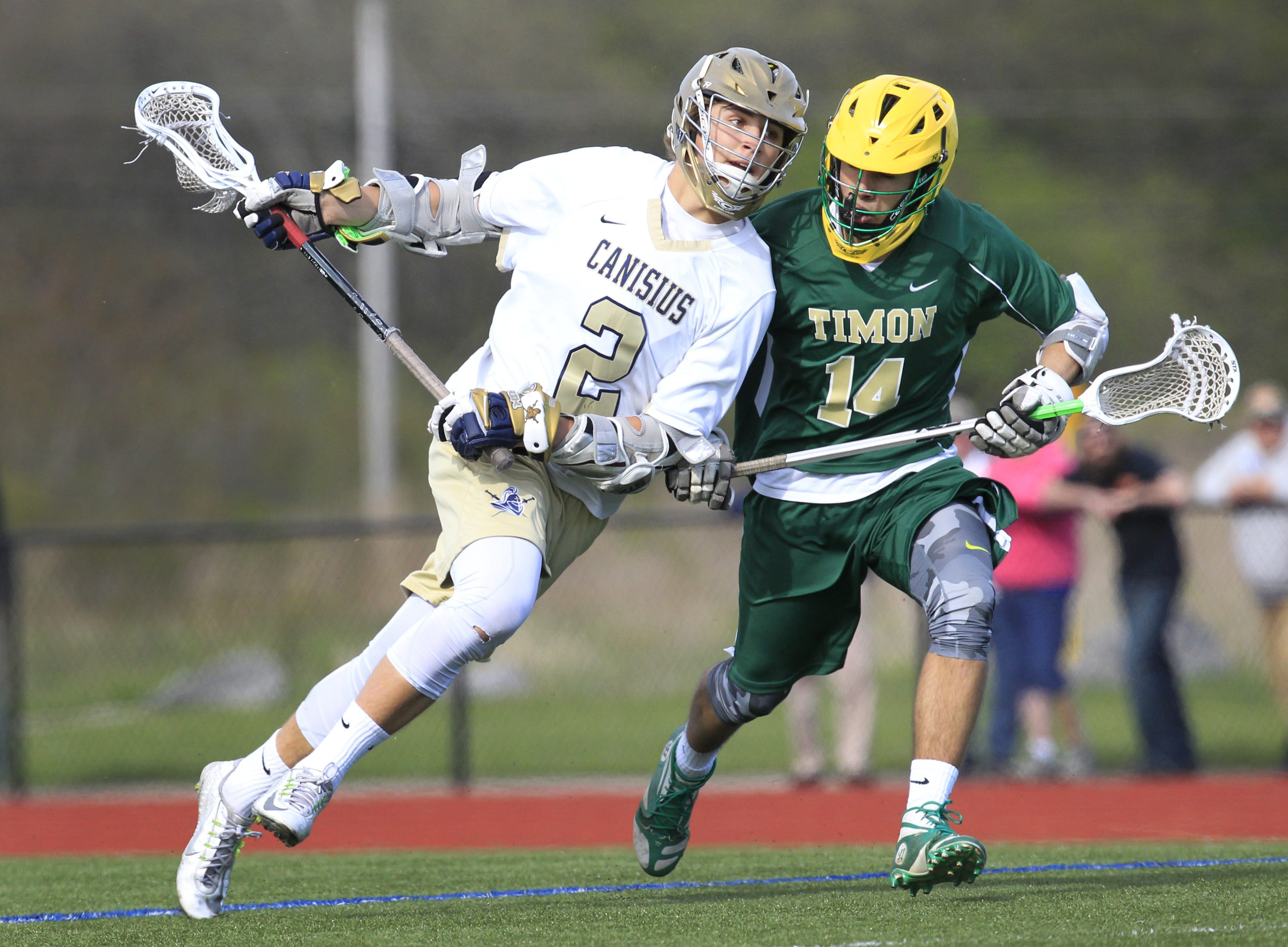 John Baldwin of Canisius moves the ball against Timon-St. Jude's Liam Grogan during the first half of the Crusaders' 14-7 victory Tuesday.