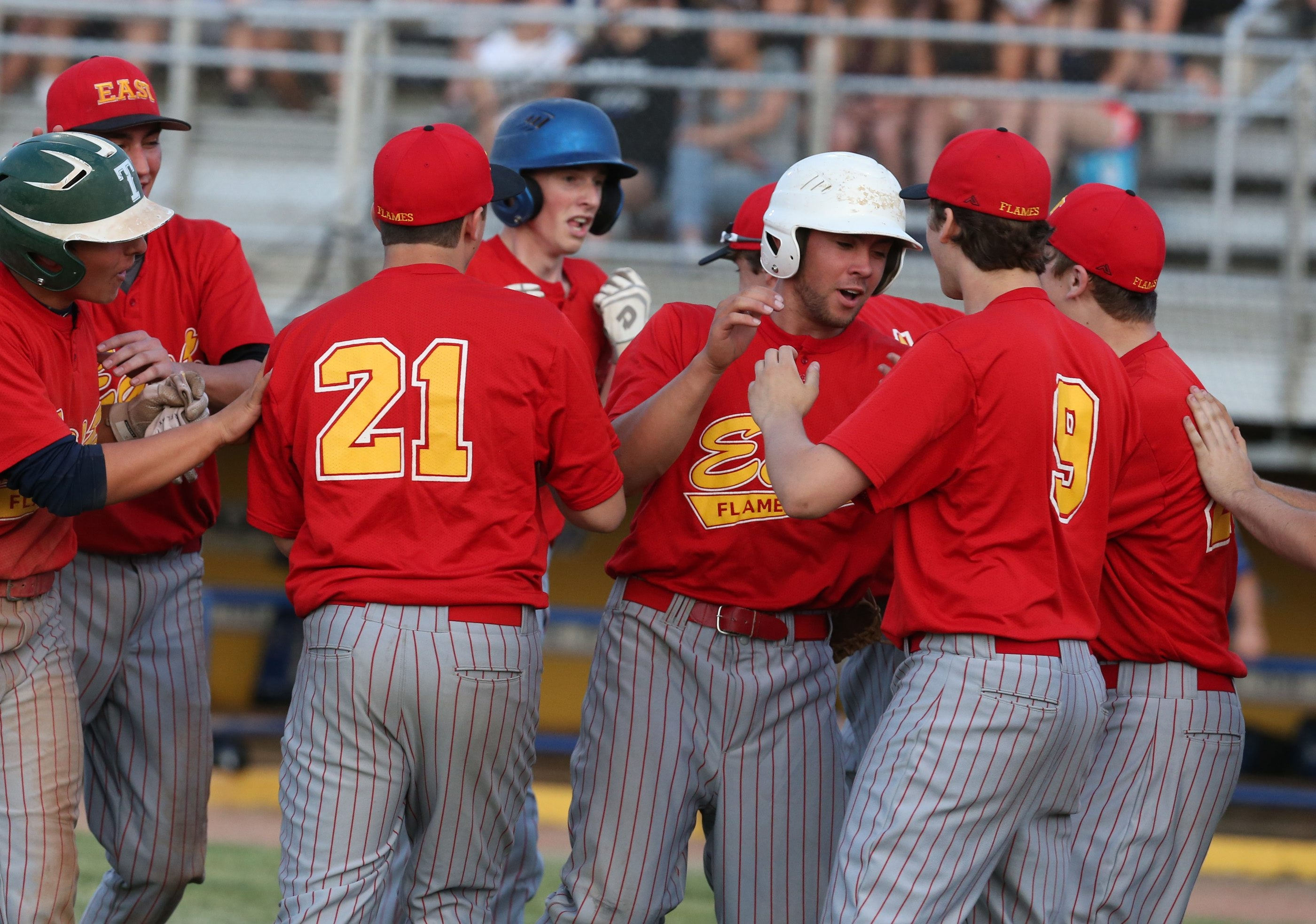 Williamsville East's Charlie Mack celebrates with his teammates after scoring in the second inning of a game with Grand Island.