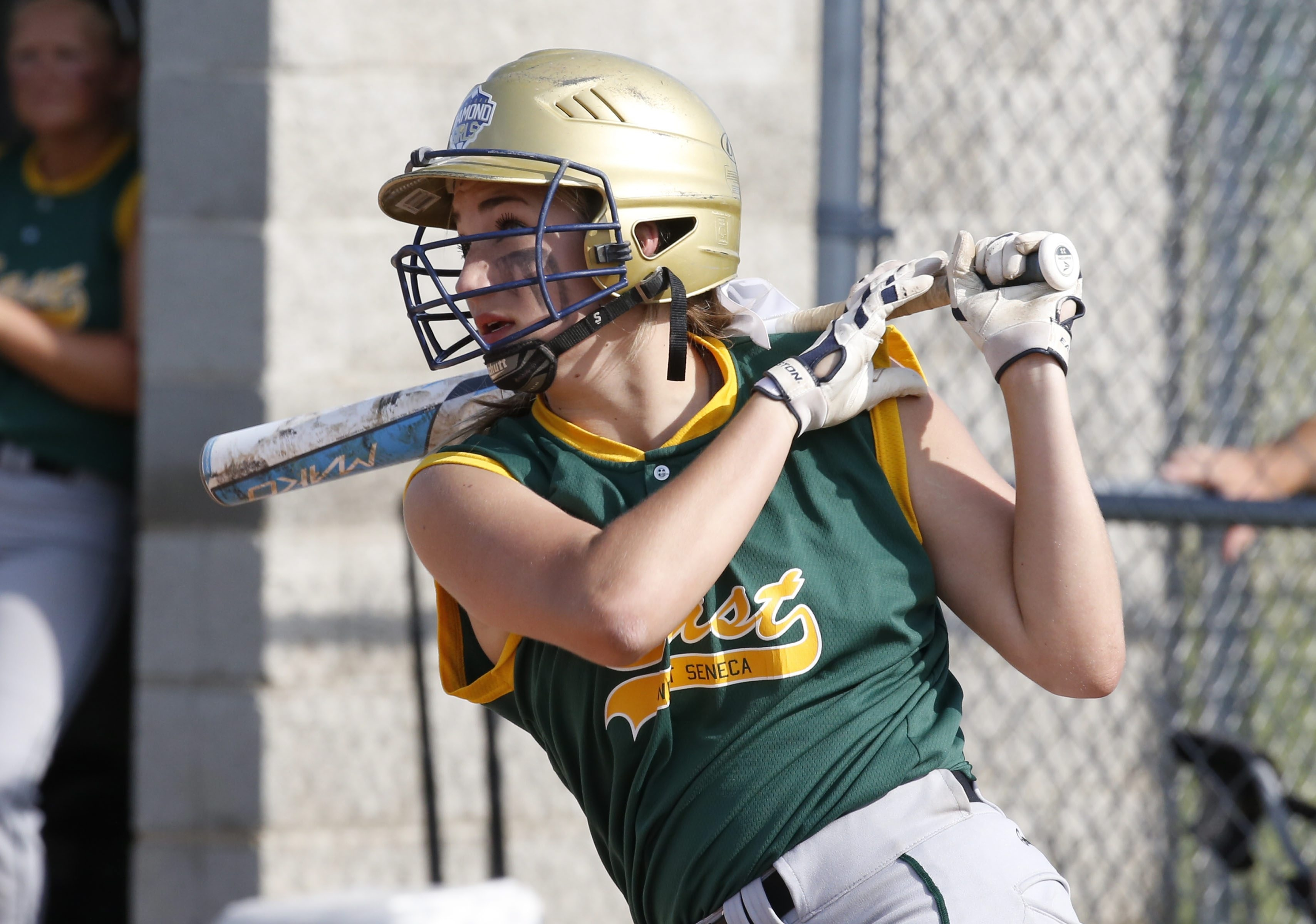 West Seneca East's Anilese Kelly hits an RBI single against Lew-Port in the Section VI Class A championship game.