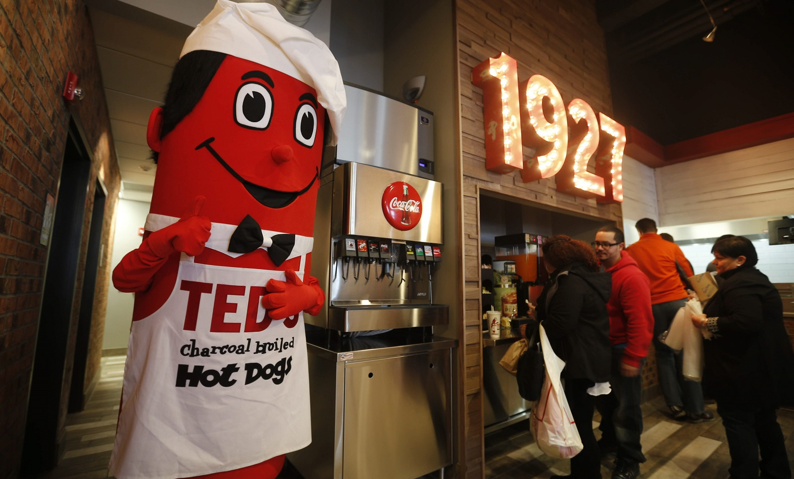 "Mascot ""Mr. Ted"" is on hand during the grand opening of Ted's Hot Dogs on Chippewa Street, Monday, Nov. 23, 2015. (Derek Gee/Buffalo News)"