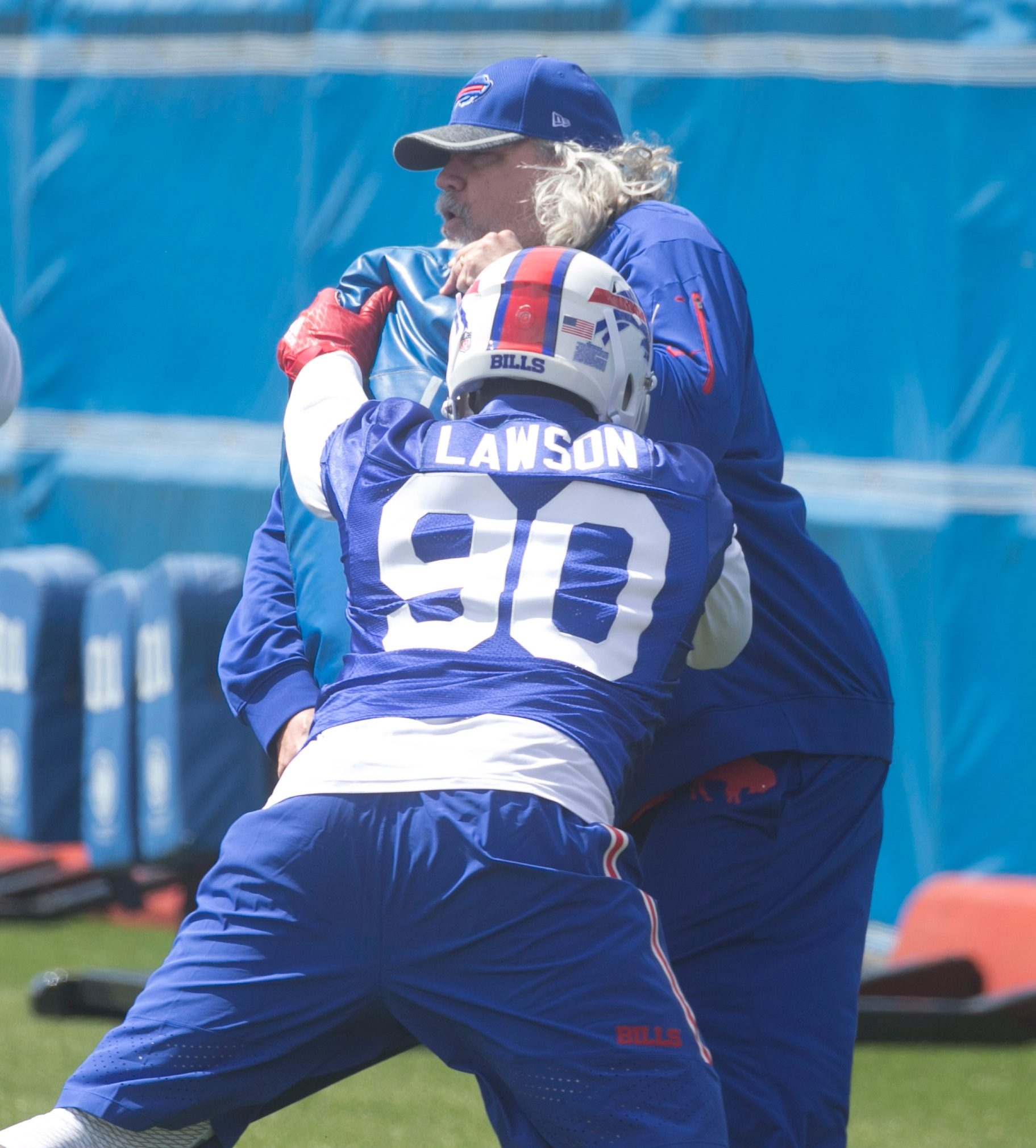 Buffalo Bills Rob Ryan,right, Assistant Head Coach/Defense is driven backward on a block by Defensive End Shaq Lawson (90),  at Bills rookie camp at the grass practice field, in Orchard Park, N.Y., on Friday May 6, 2016. (John Hickey/Buffalo News)