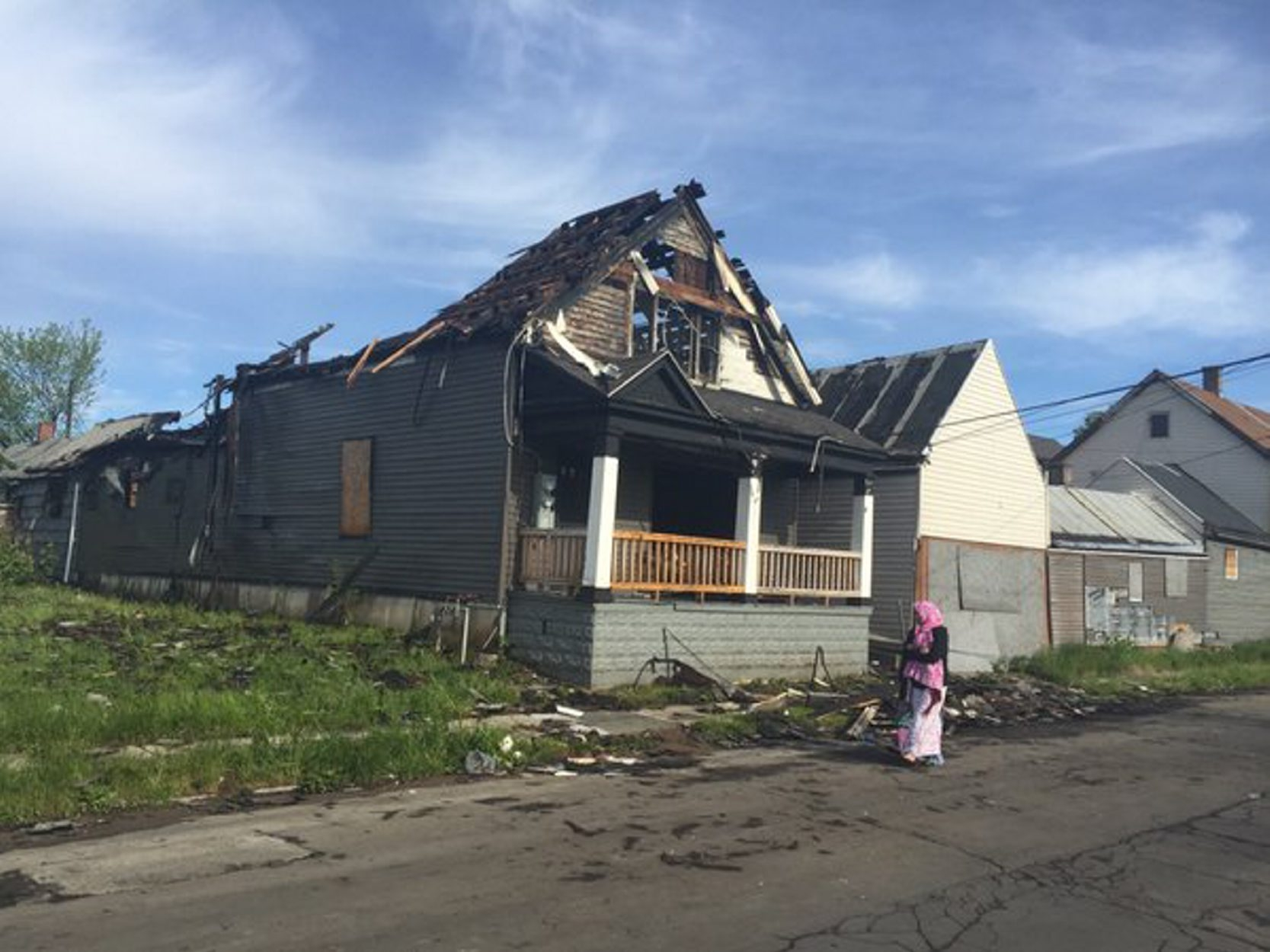 The home on Clark Street where a fire began early Wednesday and spread to neighboring structures. (John Hickey/Buffalo News)