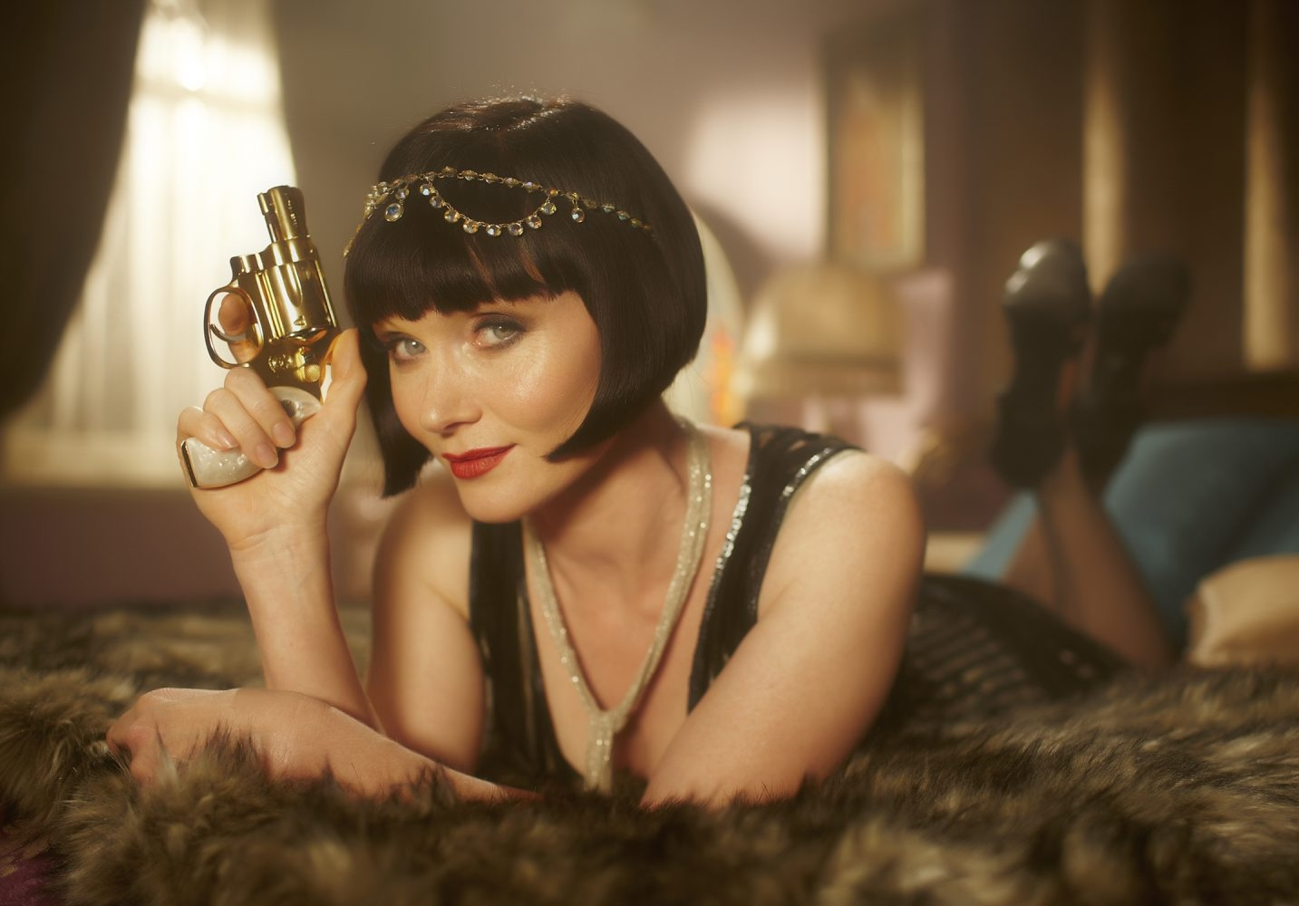 Essie Davis plays Phryne Fisher, an heiress who solves murders in 1920s Australia.