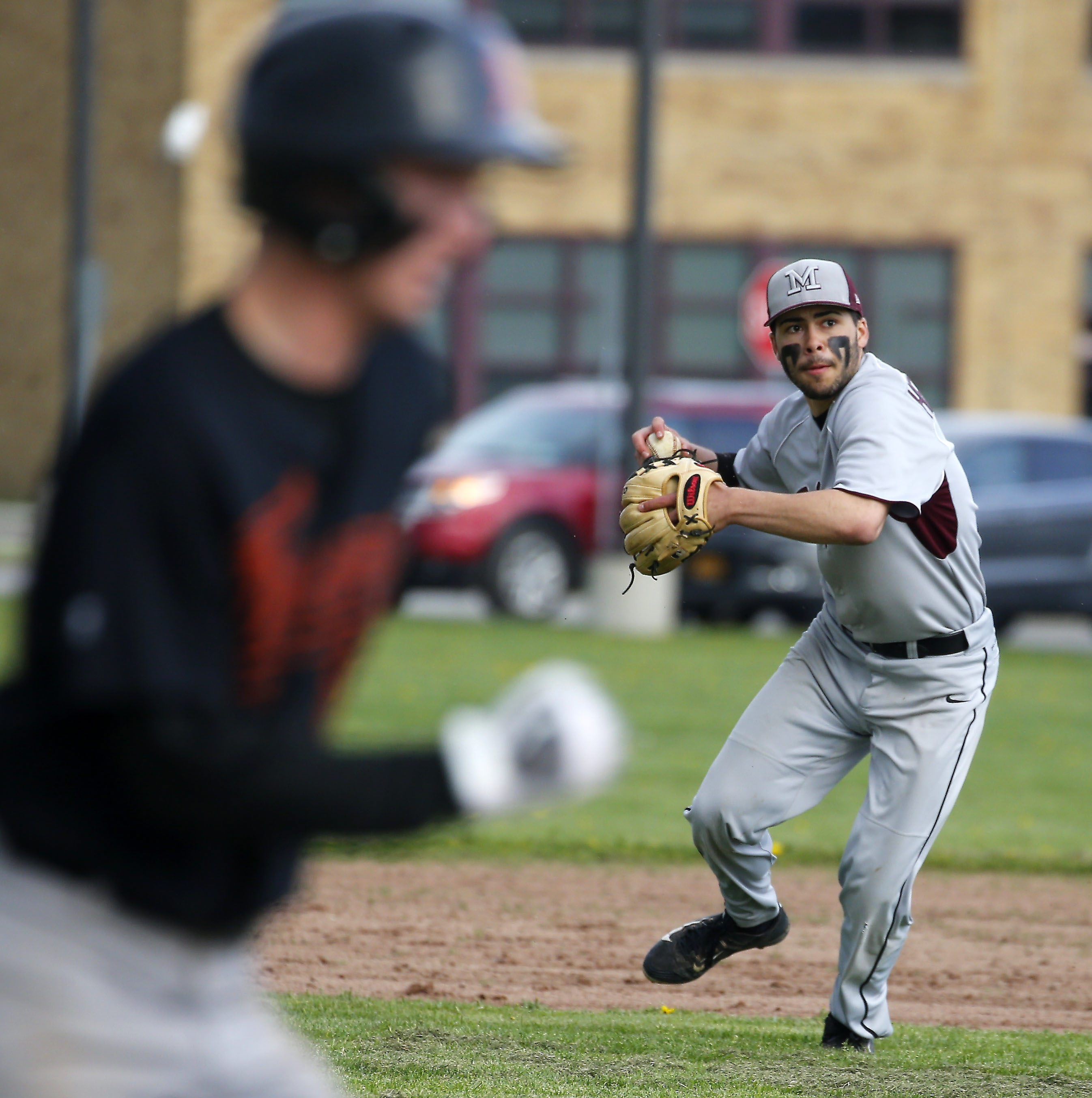 Maryvale's Anthony Hernandez makes an errant throw to first, allowing Amherst to score the winning run.