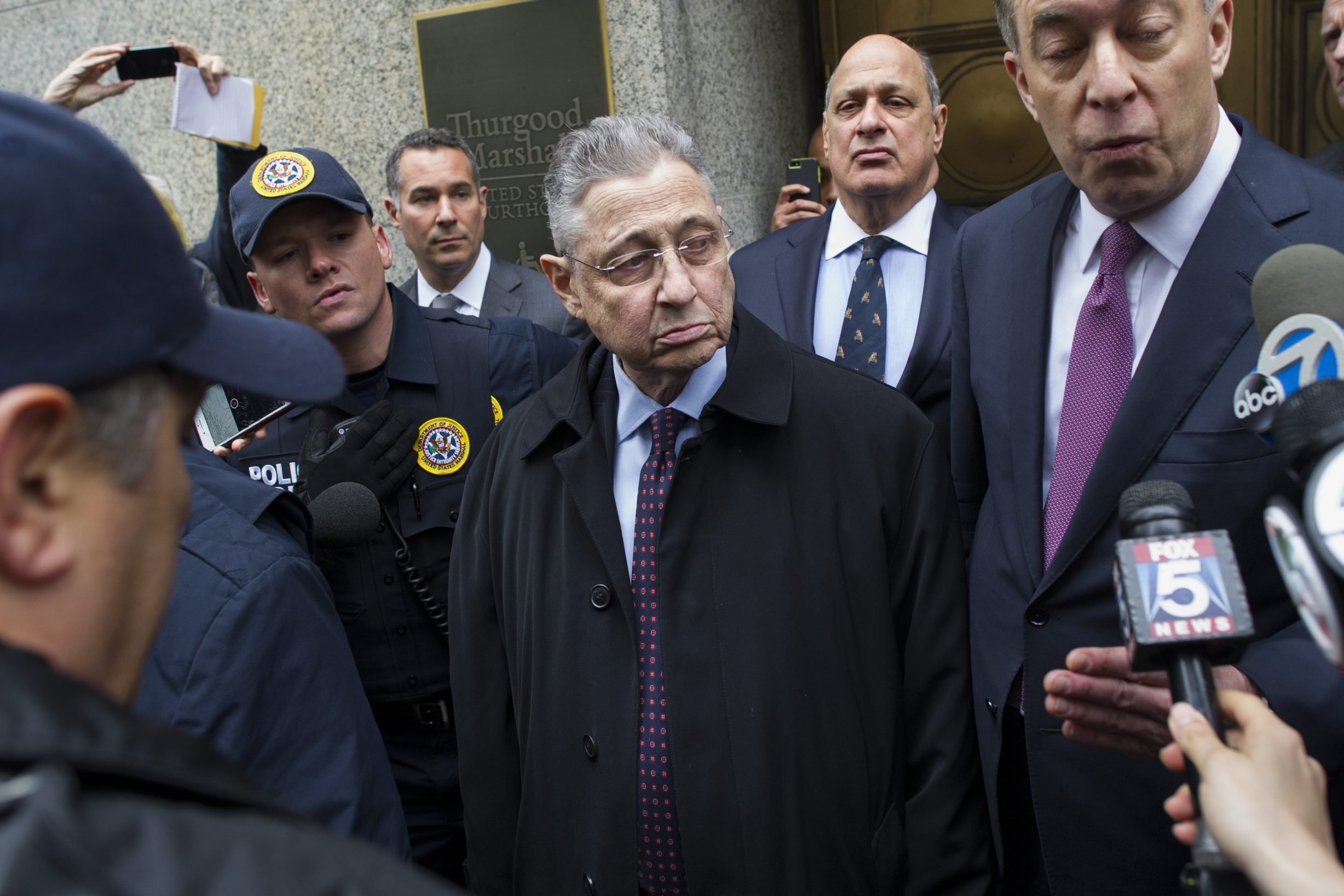 "Former Assembly Speaker Sheldon Silver leaves U.S. Courthouse in Manhattan on Tuesday after he received a 12-year prison sentence, was fined $1.75 million and was ordered to forfeit $5.3 million in ""crime proceeds"" in corruption case."
