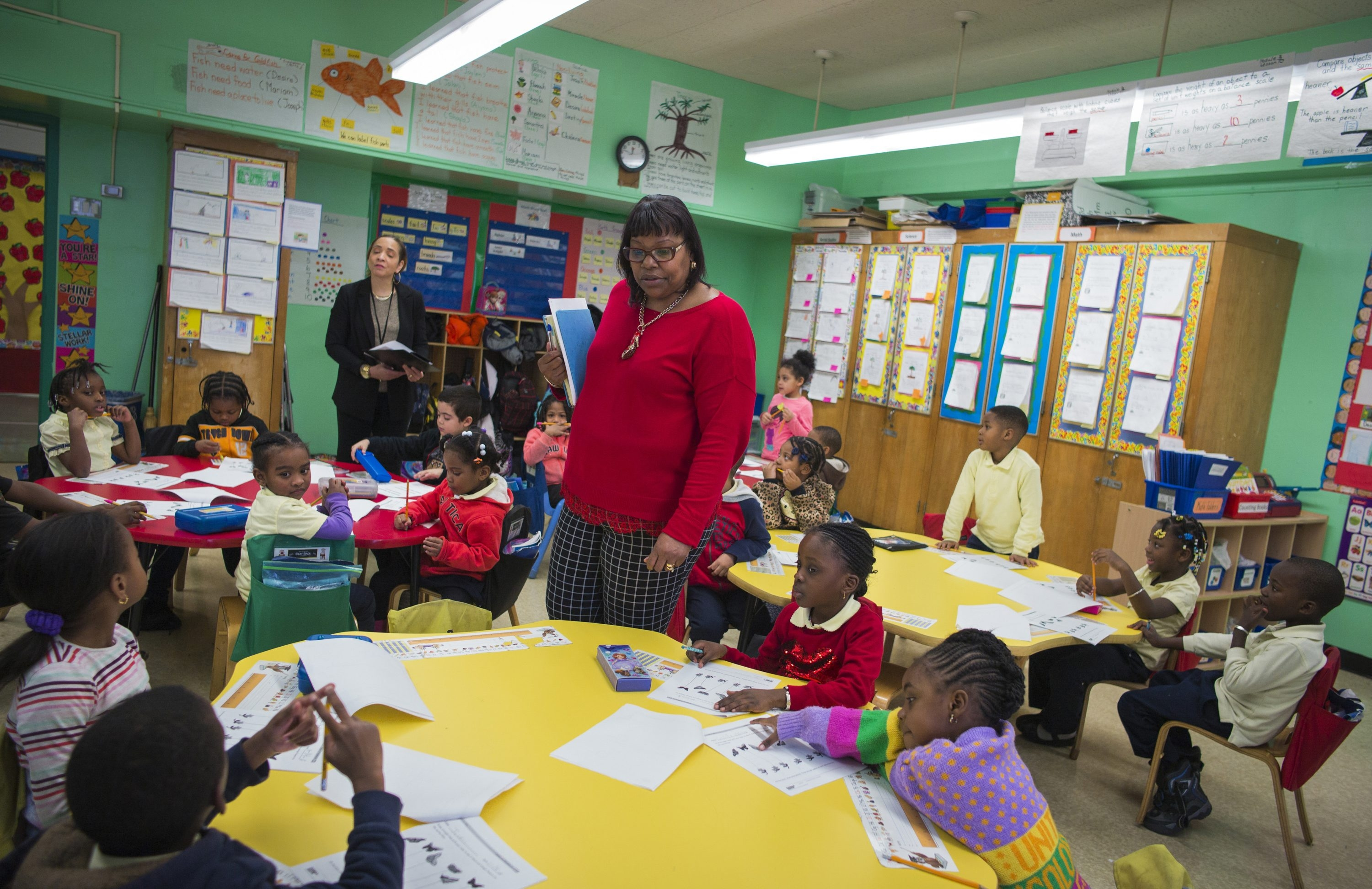 Debra Jones, principal of the Urban Scholars Community School, visits a kindergarten classroom in New York City, where many of the children face significant challenges.