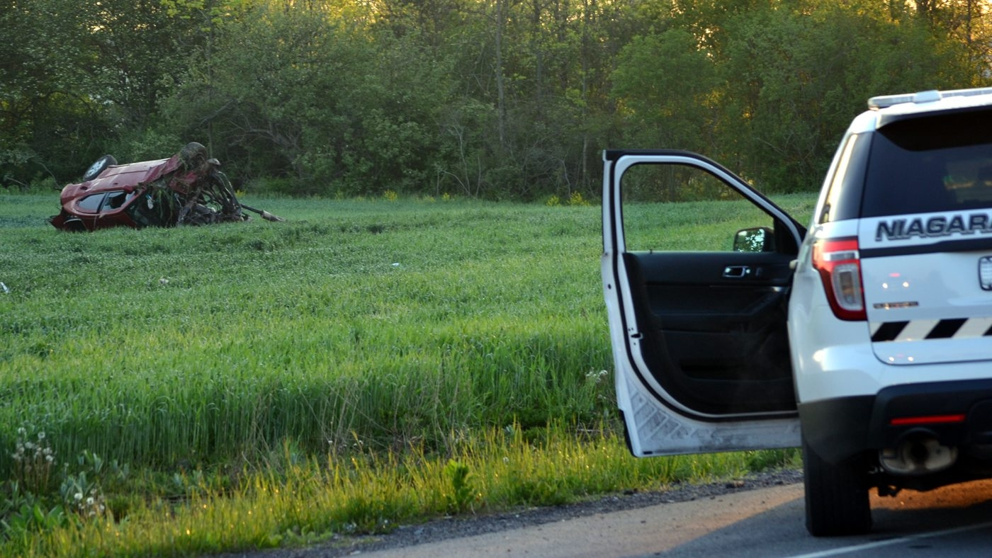 Niagara County Sheriff's deputies on the scene of a car crash in Wheatfield. (Larry Kensinger/Special to The News)