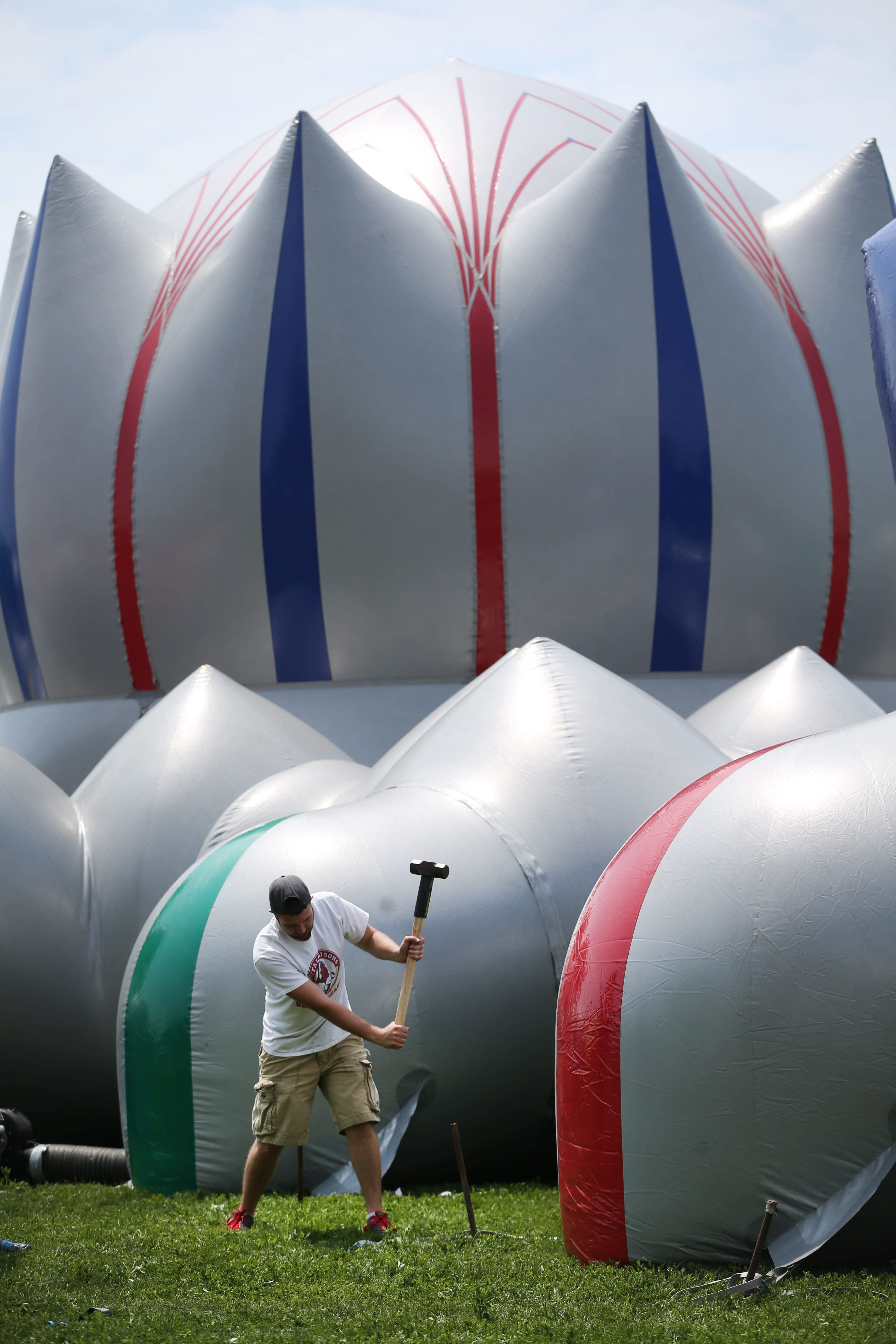 A crew secures Architects of Air's luminarium with stakes Wednesday at Wilkeson Pointe at the Outer Harbor. The walk-in inflatable sculpture will be open Thursday through Monday.