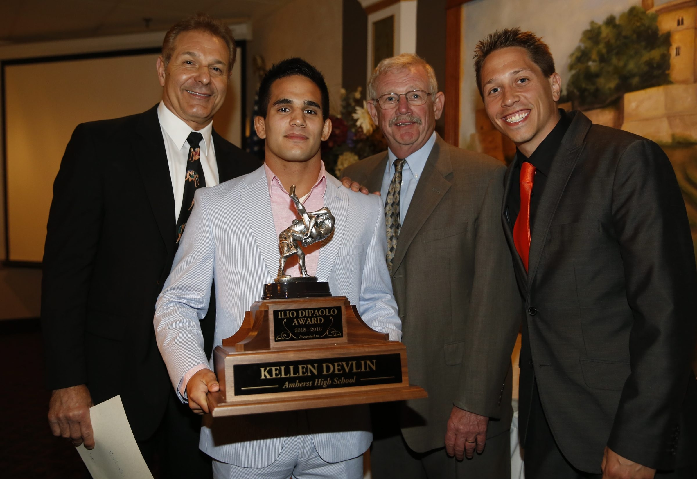 Ilio DiPaolo Scholarship Award winner Kellen Devlin holds his trophy, with selection committee members Dennis DiPaolo, left, Bud Carpenter and Kyle Illig.