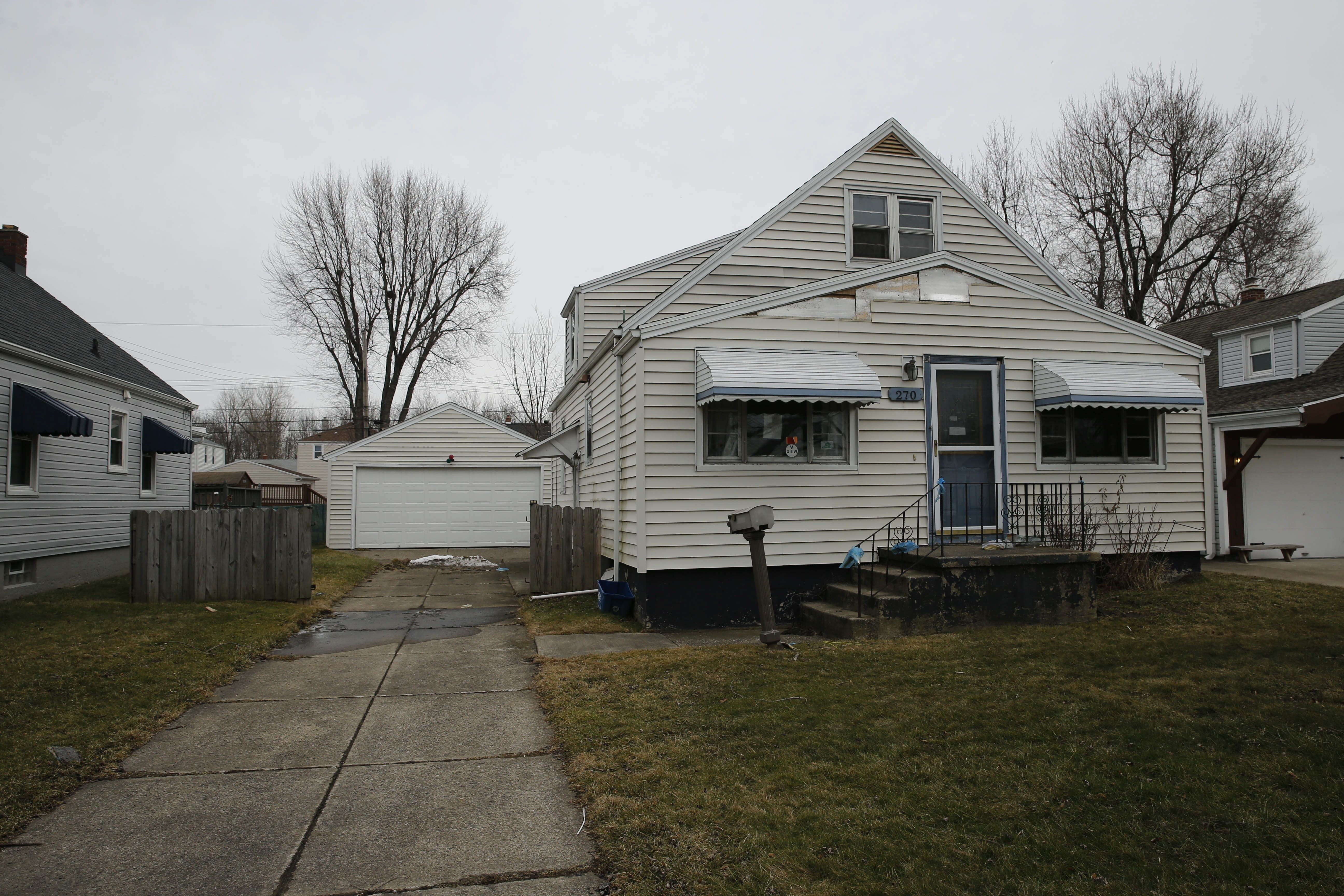 Abandoned homes awaiting completion of the foreclosure process, like this house in West Seneca earlier this year, are often left to deteriorate and can eventually drag down entire neighborhoods.