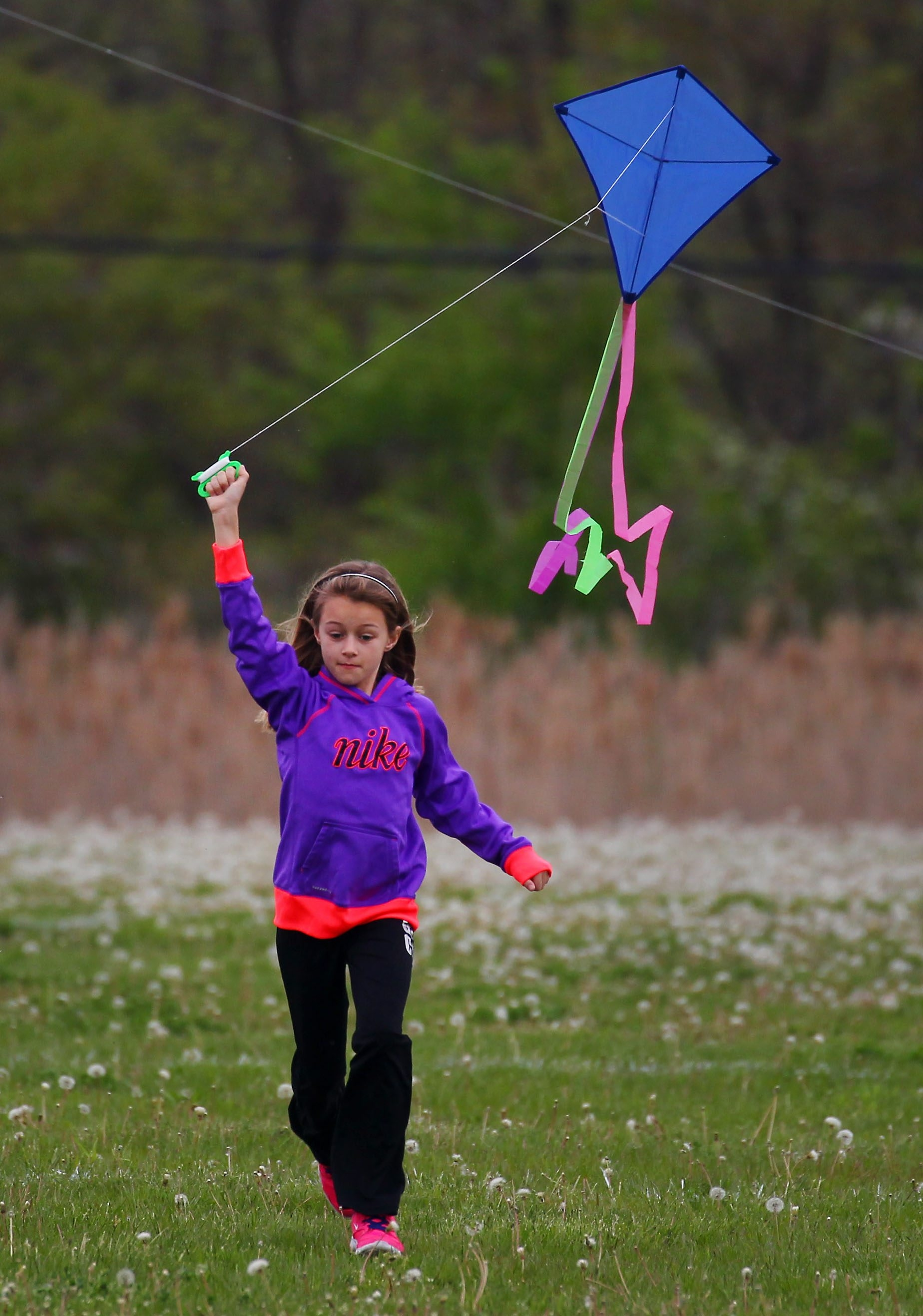 Rielly Brick tries to launch her kite Saturday at a fundraiser for homeless veterans in Gratwick-Riverside Park, North Tonawanda.