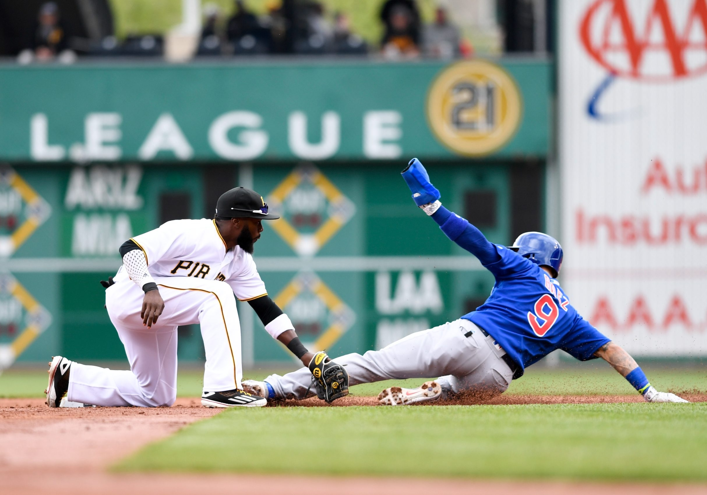 Javier Baez of the Cubs is caught stealing in a recent game against the Pirates.