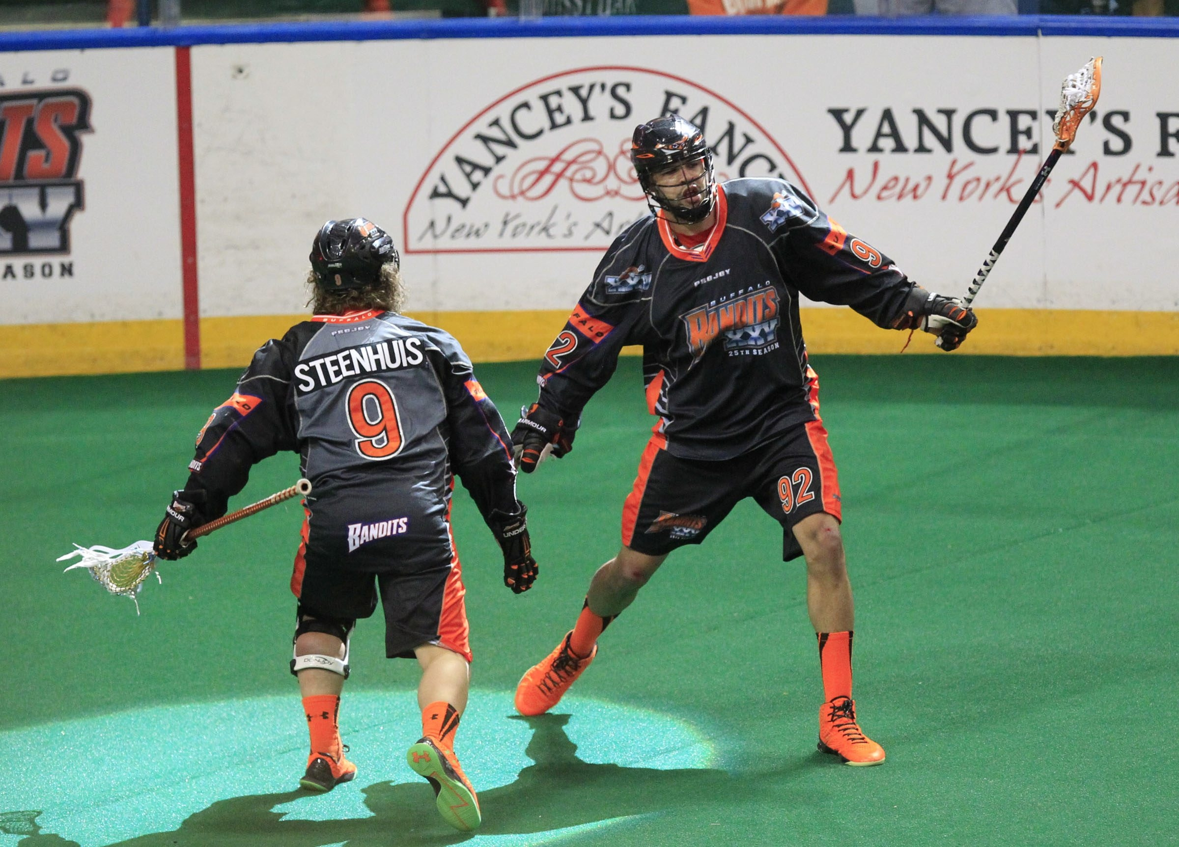 Buffalo Bandits Dhane Smith celebrates his goal with Mark Steenhuis against New England during first half action at the First Niagara Center on Saturday, April 30, 2016. (Harry Scull Jr./Buffalo News)