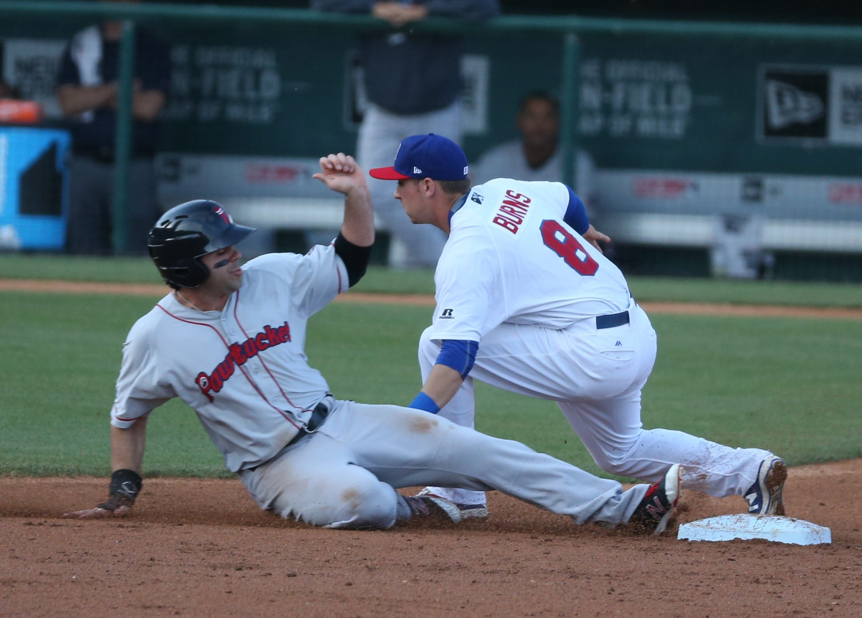 Pawtucket's Ryan LaMarre is tagged out while stealing by Buffalo's Andy Burns Friday at Coca-Cola Field.