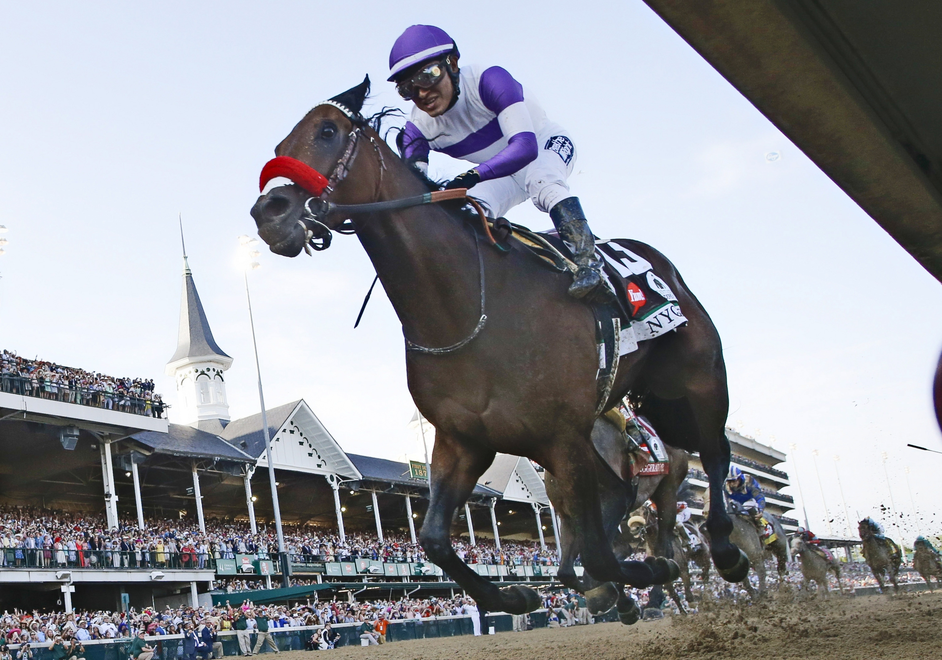 Jockey Mario Gutierrez has been aboard all eight of Nyquist's career races, including his Kentucky Derby win on May 7.  (Mark Cornelison/Lexington Herald-Leader/TNS)
