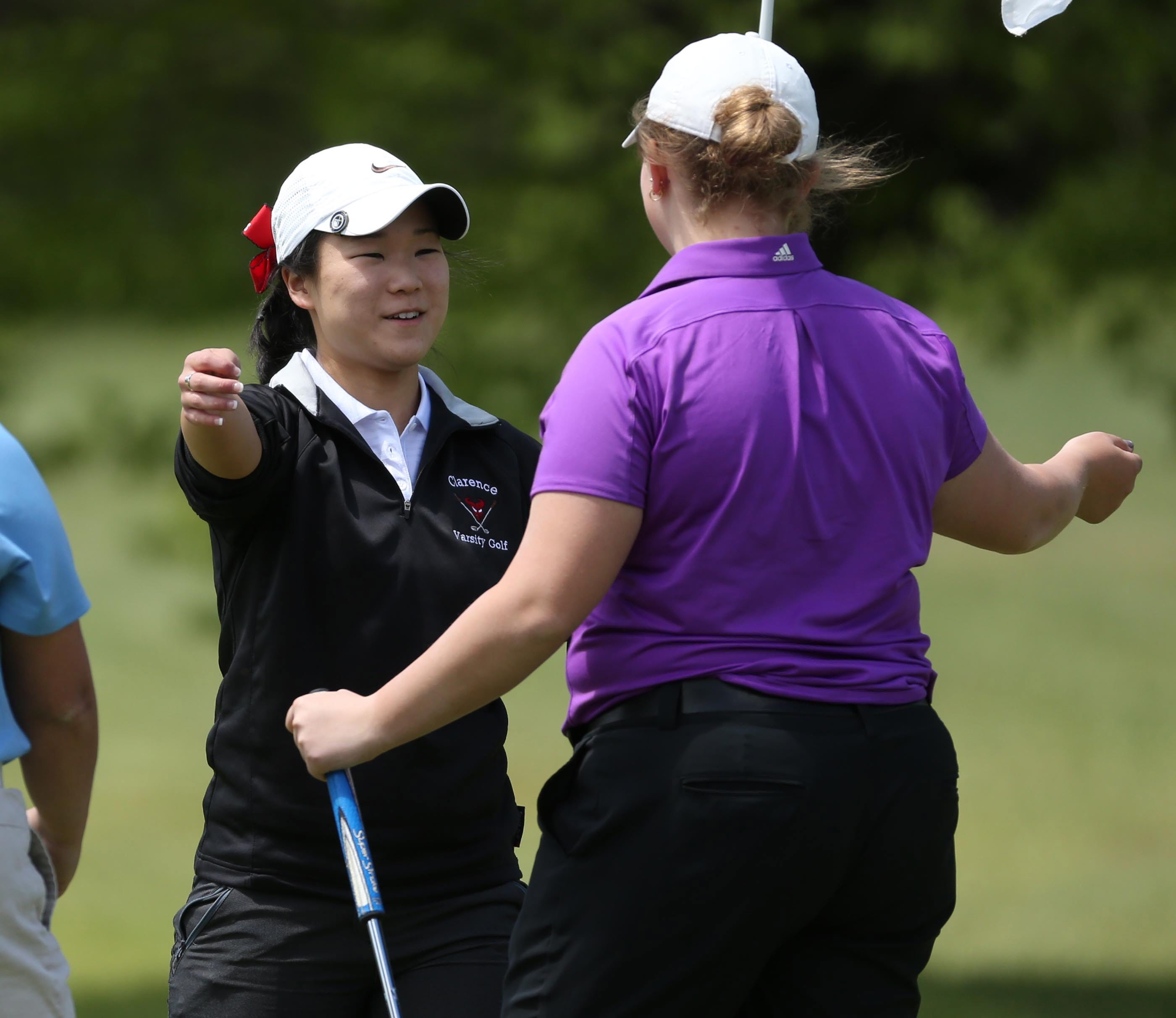 Alexis Kim, left, is congratulated by fellow competitor Marissa DelMonaco on her win in the Section VI girls golf championship Wednesday at Gowanda Country Club. DelMonaco took second place.