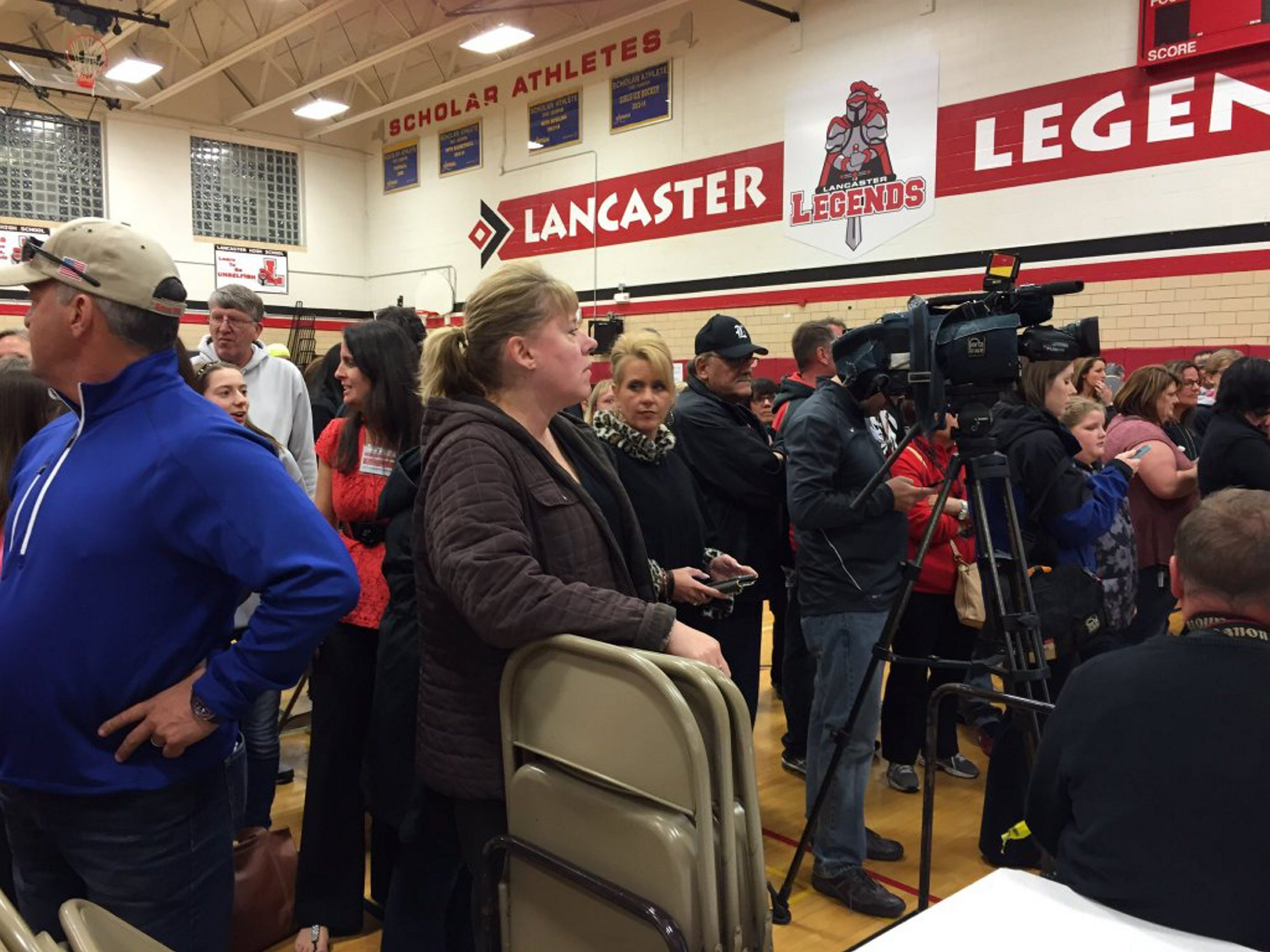 Residents in the Lancaster School District wait to hear results from the school board vote. (Karen Robinson/Buffalo News)