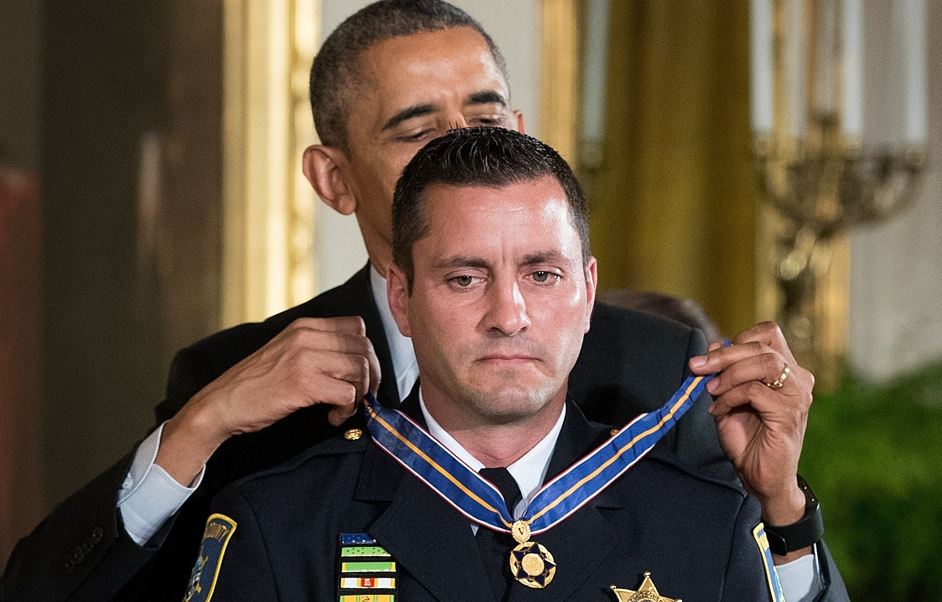 President Barack Obama presents Niagra County Sheriff's Deputy Joseph Tortorella with the Medal of Valor during a ceremony in the East Room of the White House on May 16, 2016, in Washington, D.C. (Getty Images)