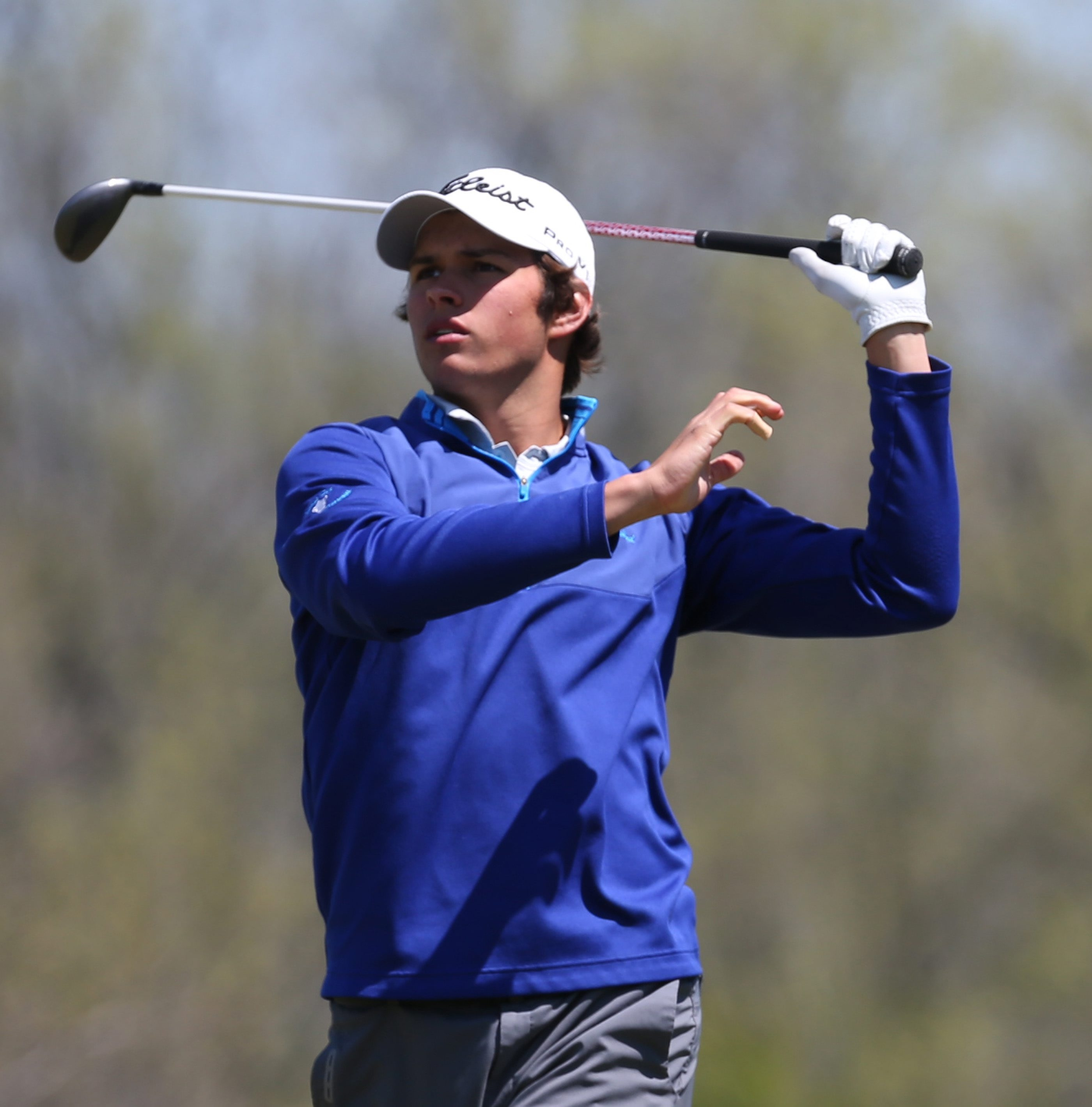 Ben Reichert watches his tee shot take flight on the 11th hole during the Section VI boys golf state qualifier at River Oaks Golf Club. Reichert is going to states for the fourth time in his career.