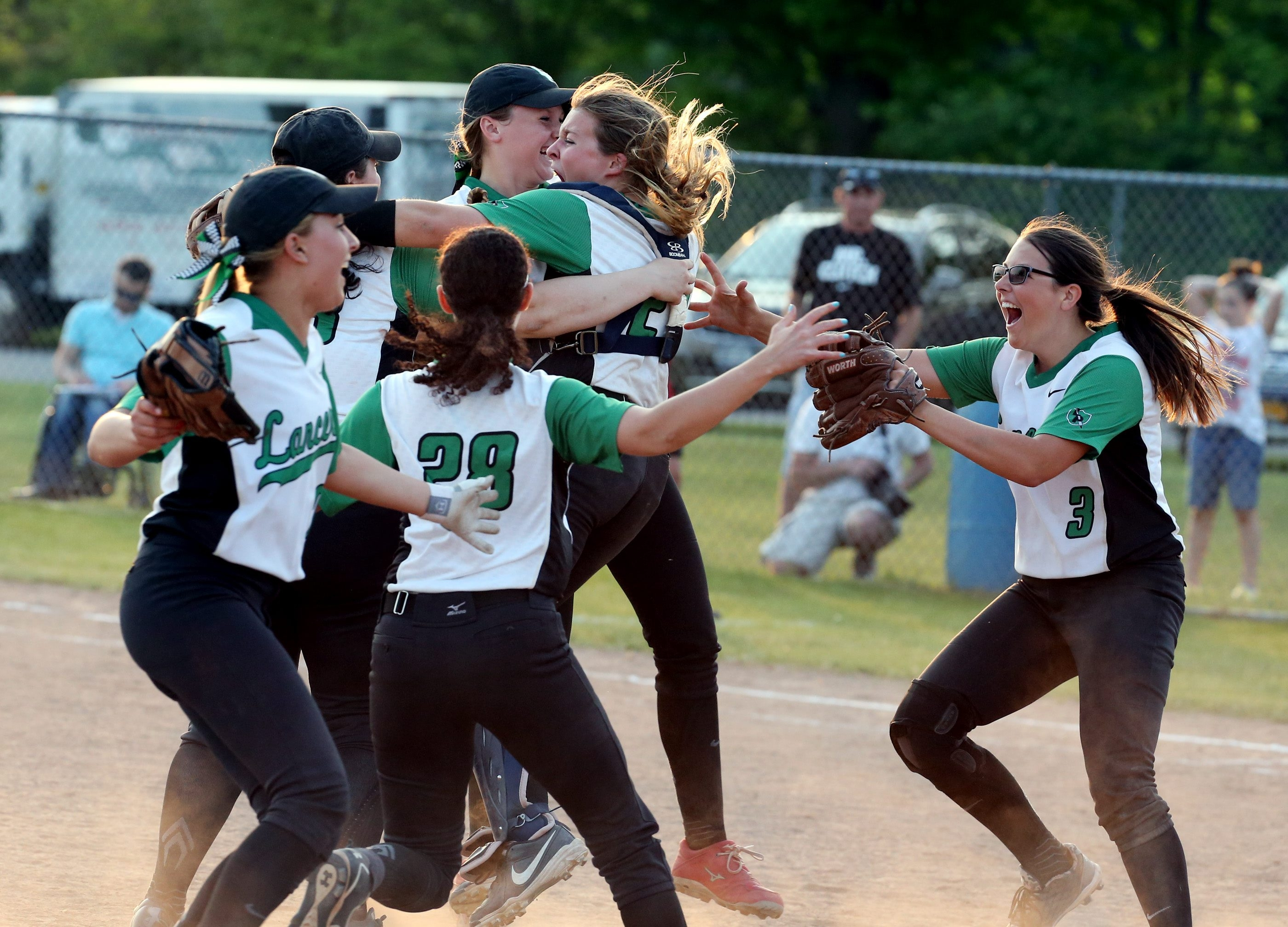 Lewiston-Porter players celebrate after beating Starpoint, 3-2, in the Section VI Class A-2 championship game at Depew on Wednesday.