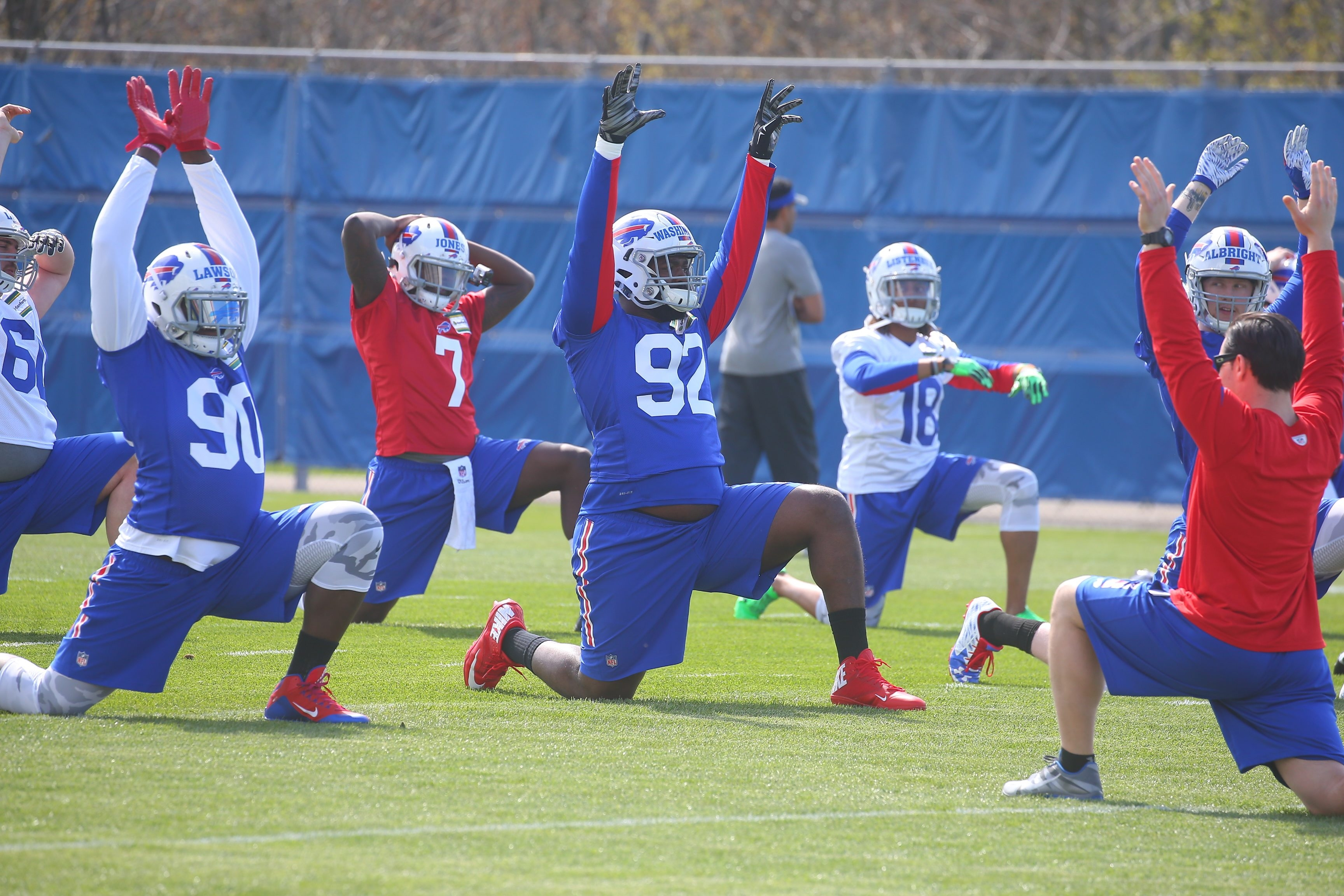 Buffalo Bills defensive end Shaq Lawson (90), and Bills defensive tackle Adolphus Washington (92) stretch at Bills rookie camp at the grass practice field, in Orchard Park, N.Y., on Friday May 6, 2016. (John Hickey/Buffalo News)