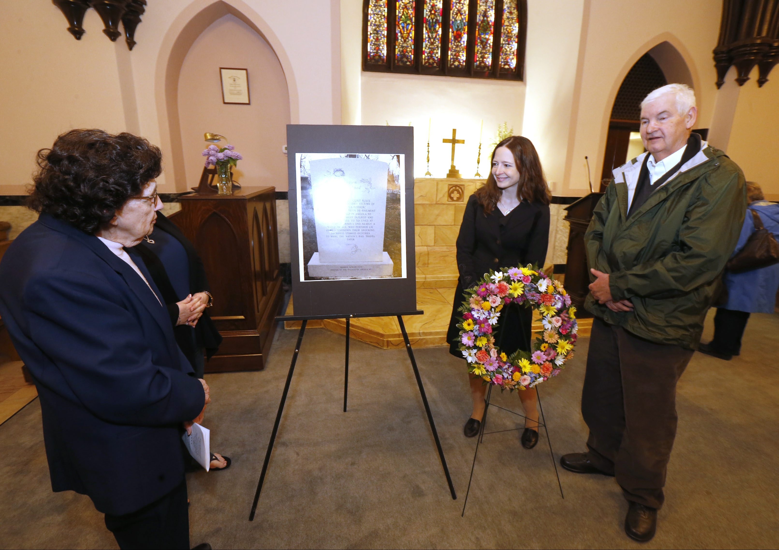 "Angola historian Joan M. Houston, left, Charity Vogel and Angola Mayor William ""Hub"" Frawley were part of a dedication ceremony Saturday at the Chapel at Forest Lawn Cemetery."