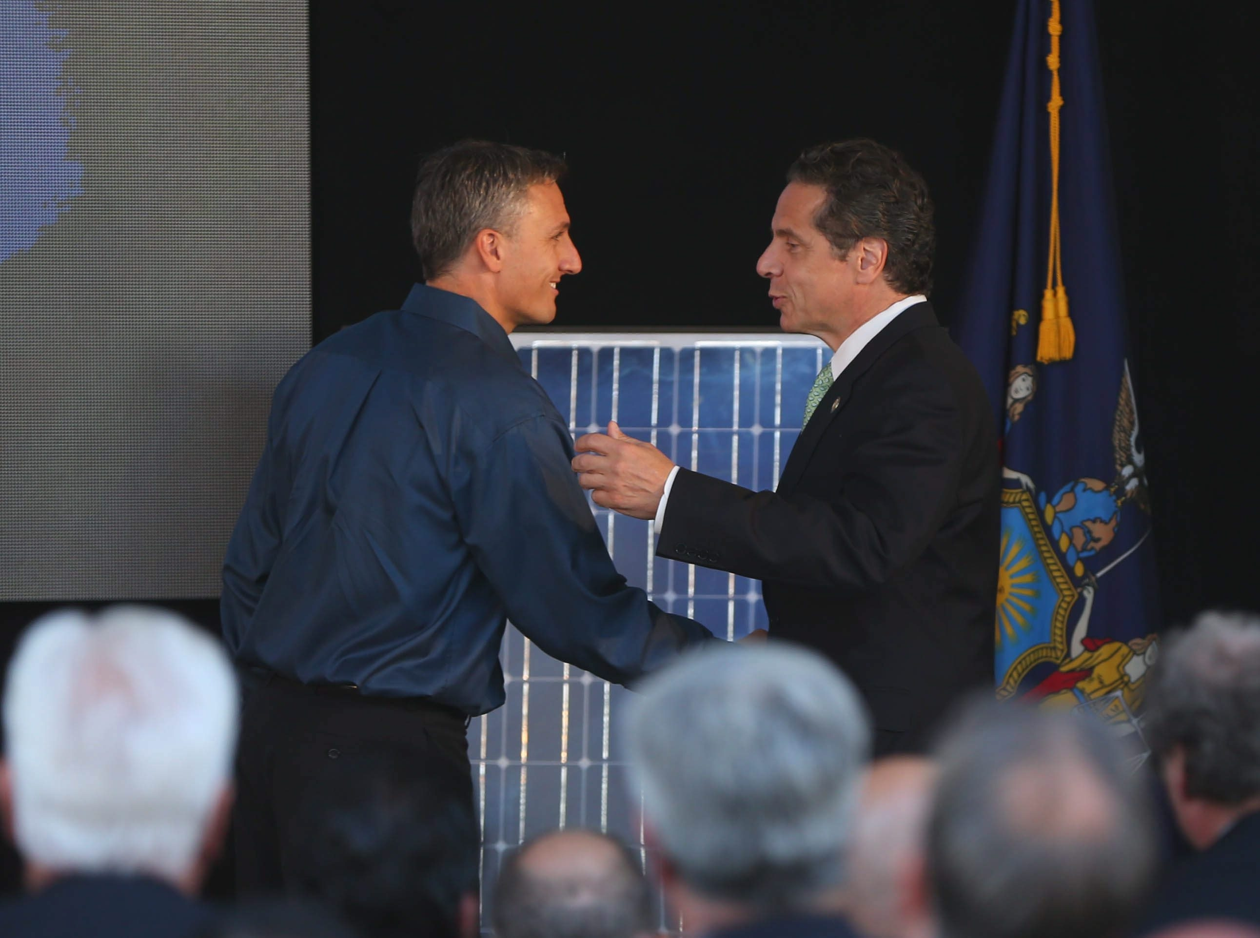 Gov.  Andrew Cuomo shakes hands with SolarCity CEO Lyndon Rive during the announcement of the Riverbend project in South Buffalo  Sept. 23, 2014.  (Mark Mulville/Buffalo News file photo)