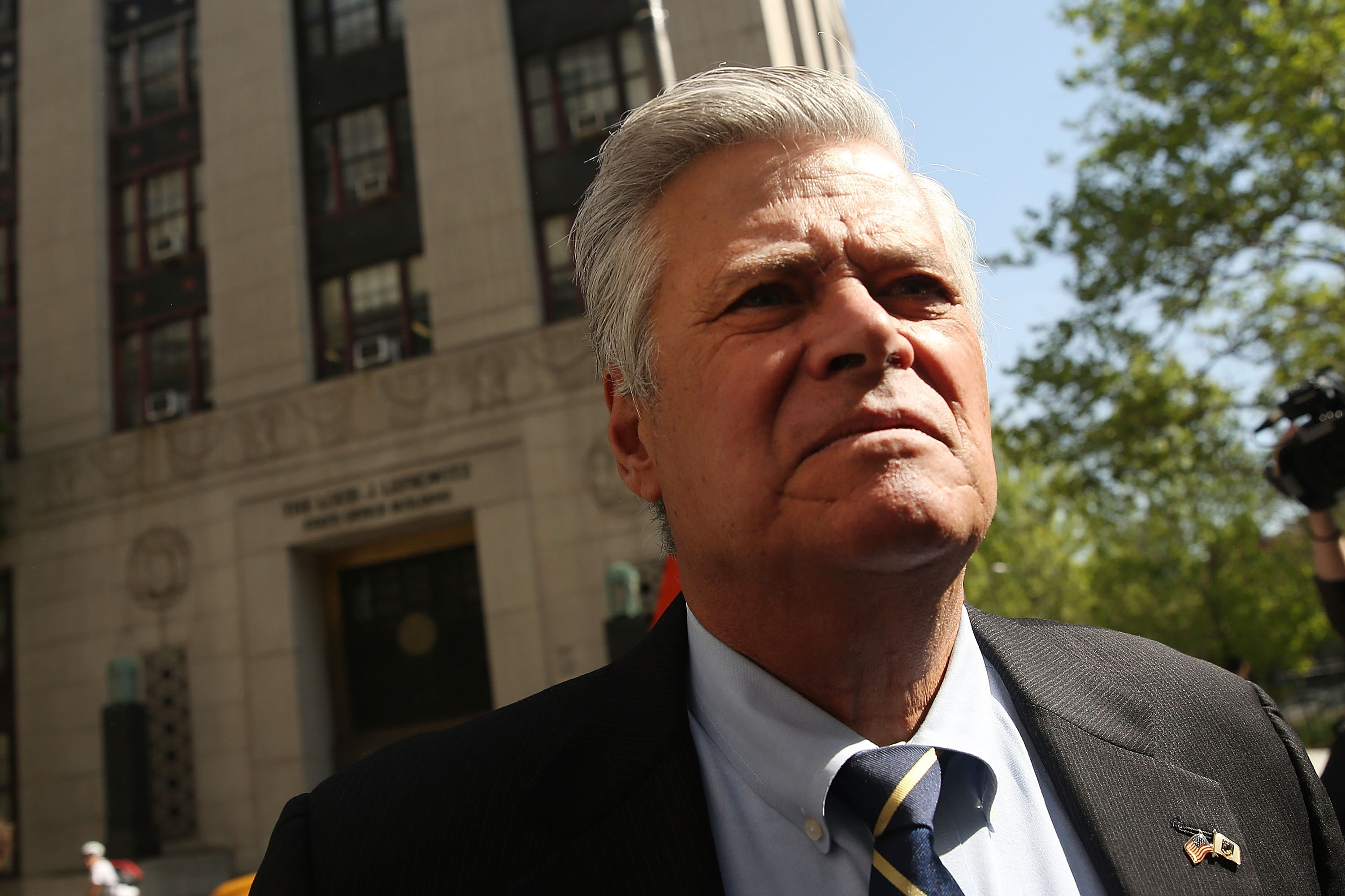Former New York State Senate Majority Leader Dean Skelos walks into a Manhattan court for his sentencing Thursday in New York. (Getty Images)
