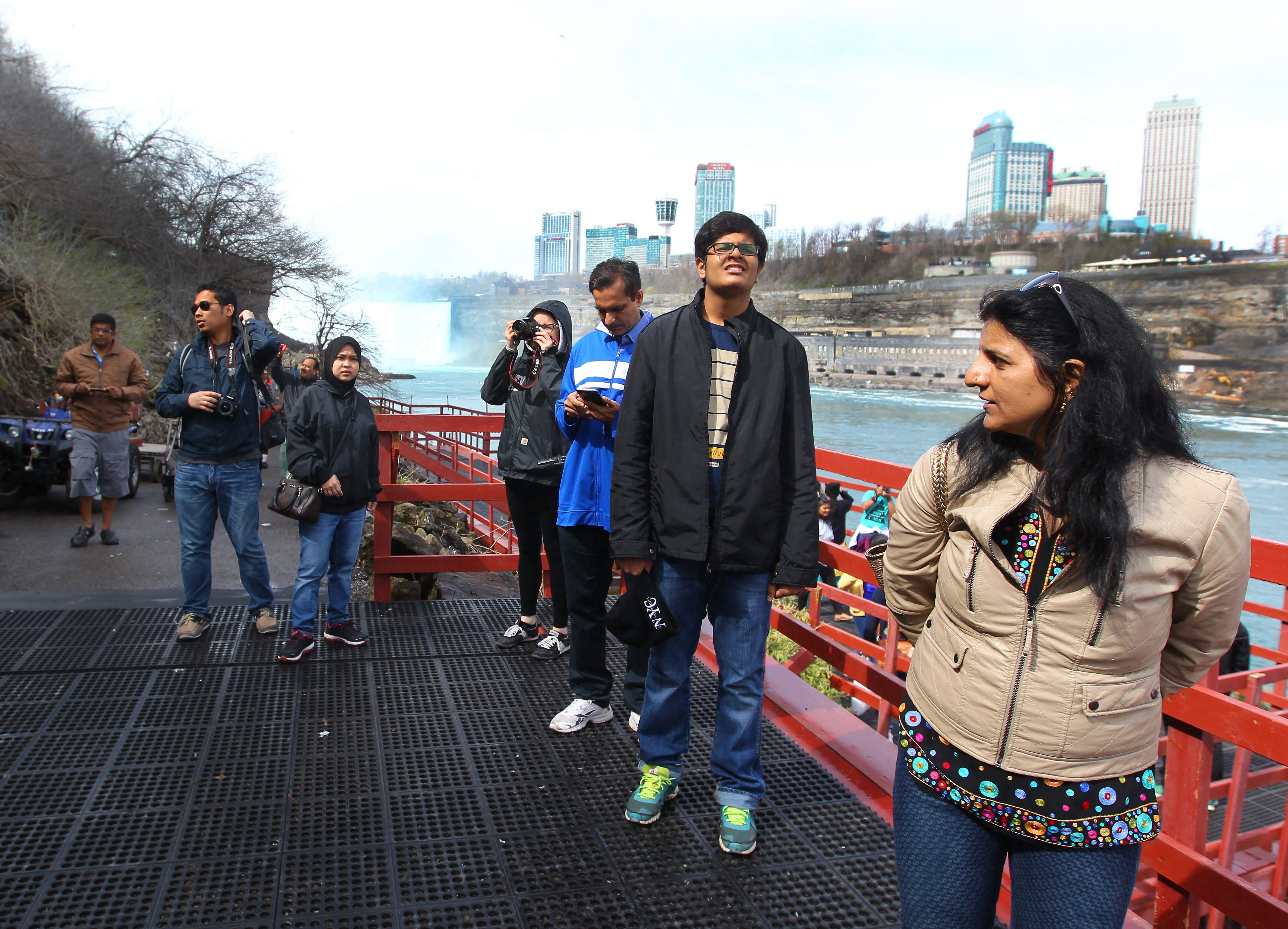 Tourists snap photos on one of the open viewing platforms at the Cave of the Winds on Goat Island in Niagara Falls.