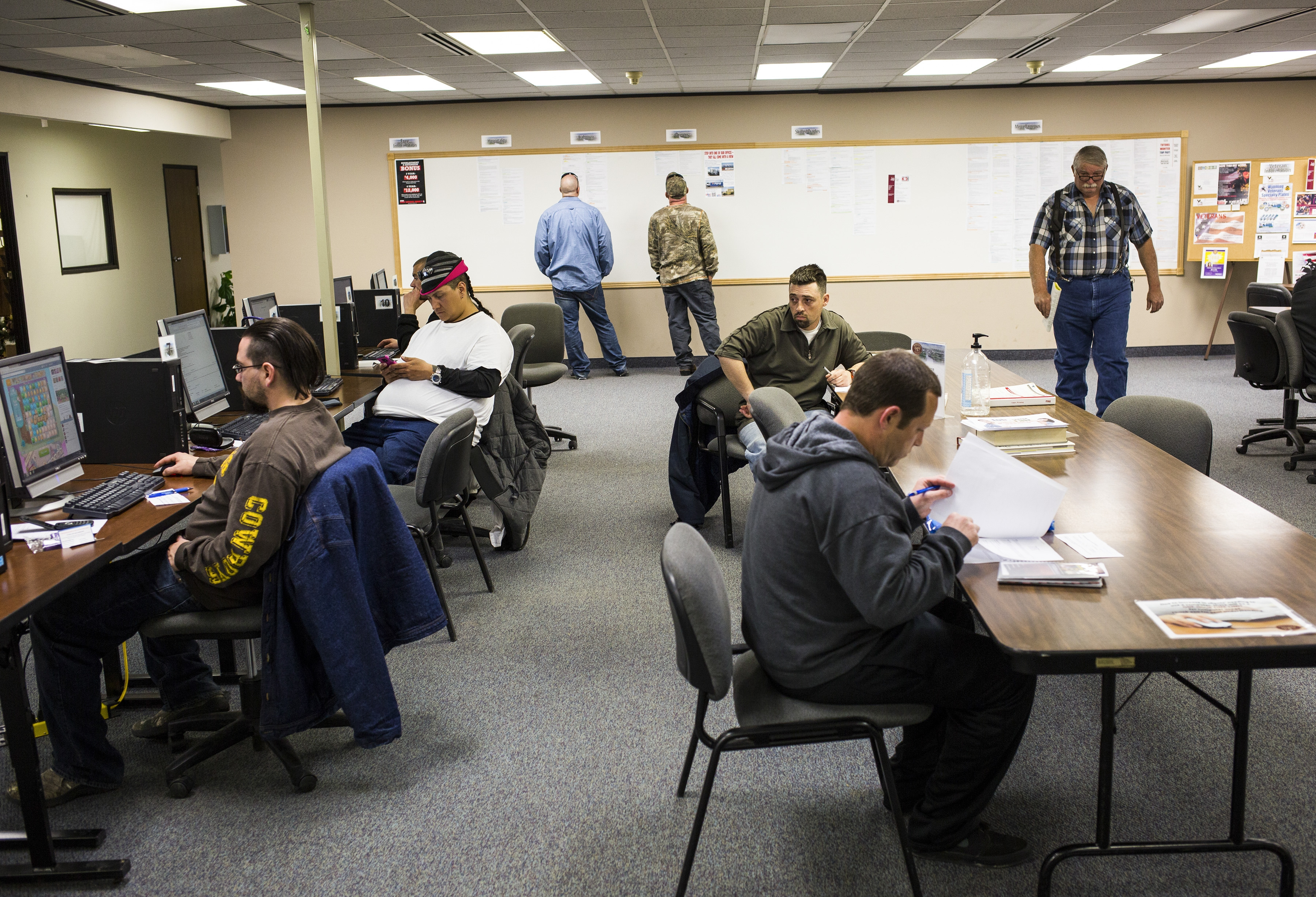 Job seekers use resources at the Department of Workforce Services in Casper, Wyo., to search for employment in April as the nation's economic growth slowed and hiring fell. (New York Times)