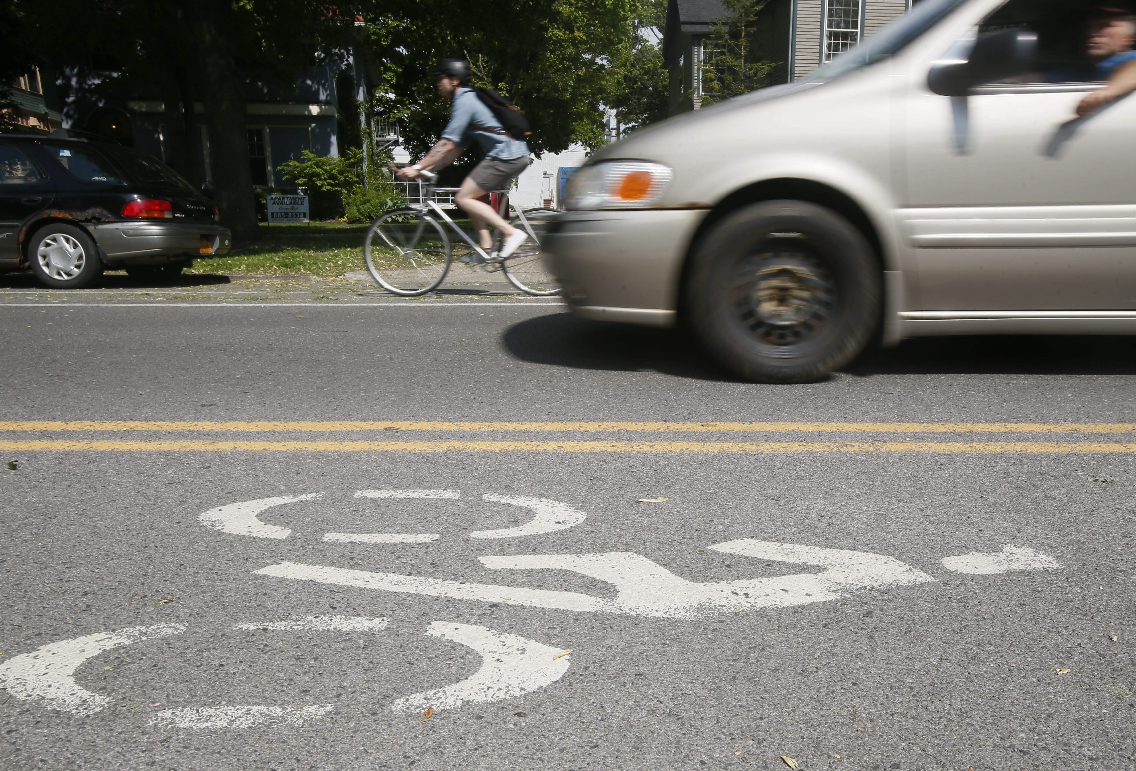 A cyclist rides in the bike lane on Linwood Avenue. (Derek Gee/News file photo)
