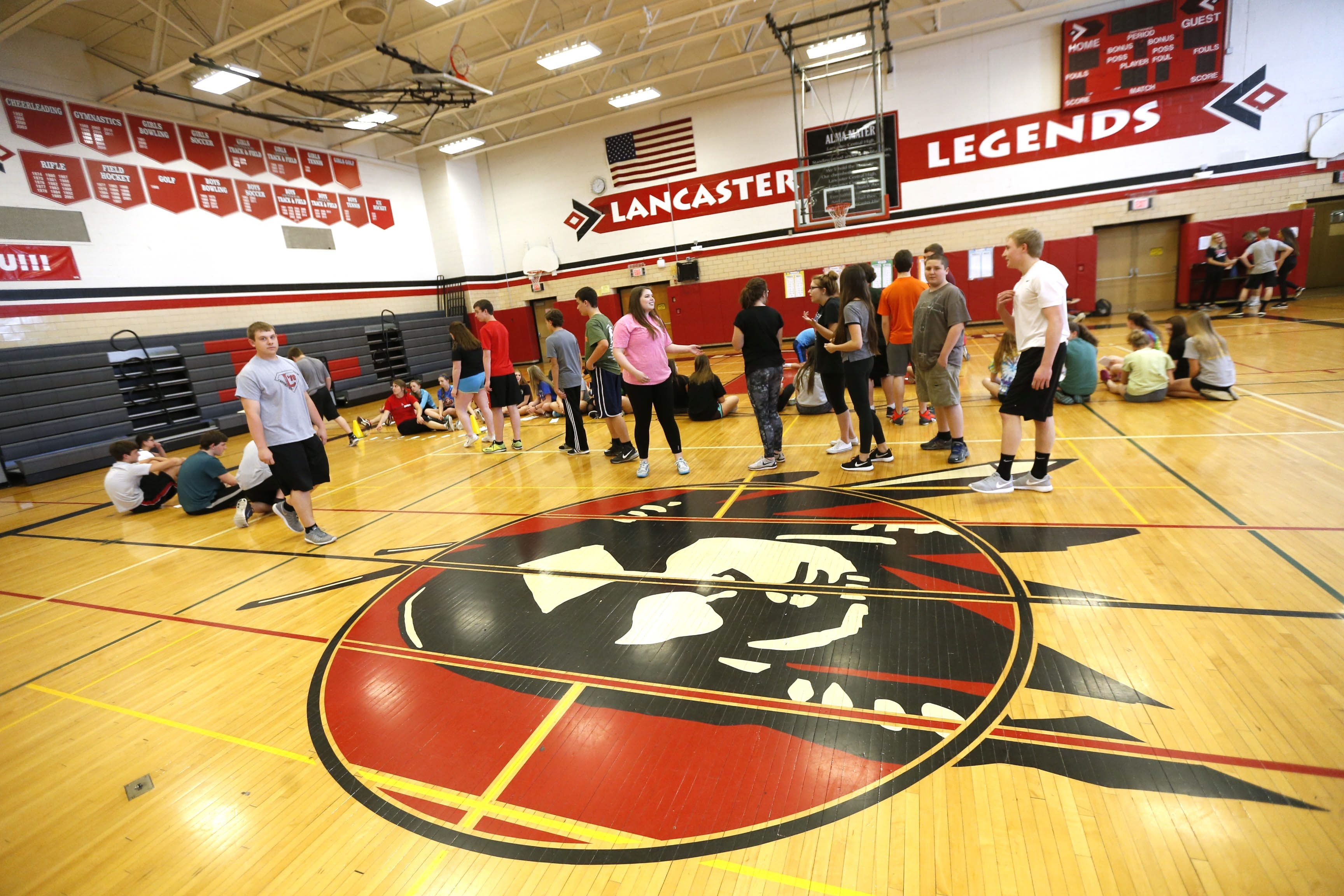 The gym at Lancaster High School has the new mascot on the wall and the old on the floor – the picture but not the name.