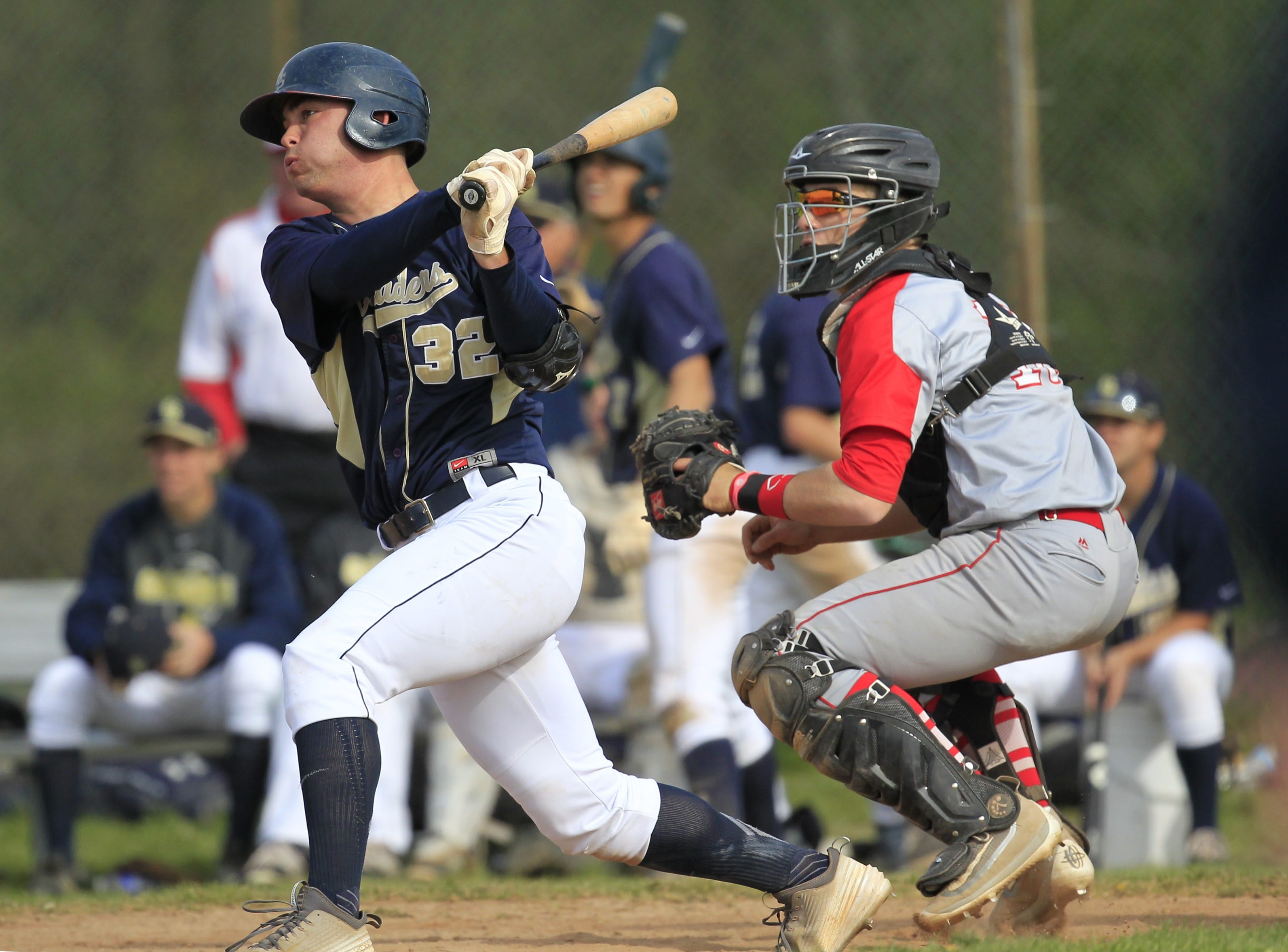 Canisius High School's Dan Dallas hits a double against St. Francis in Tuesday's game between two top local teams.