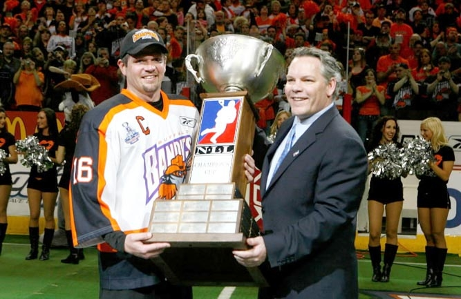 Rich Kilgour is handed the Championship Cup by NLL Commisioner Jim Jennings after the Bandits captured the 2008 NLL title with a 14-13 victory over Portland. (John Hickey/Buffalo News)