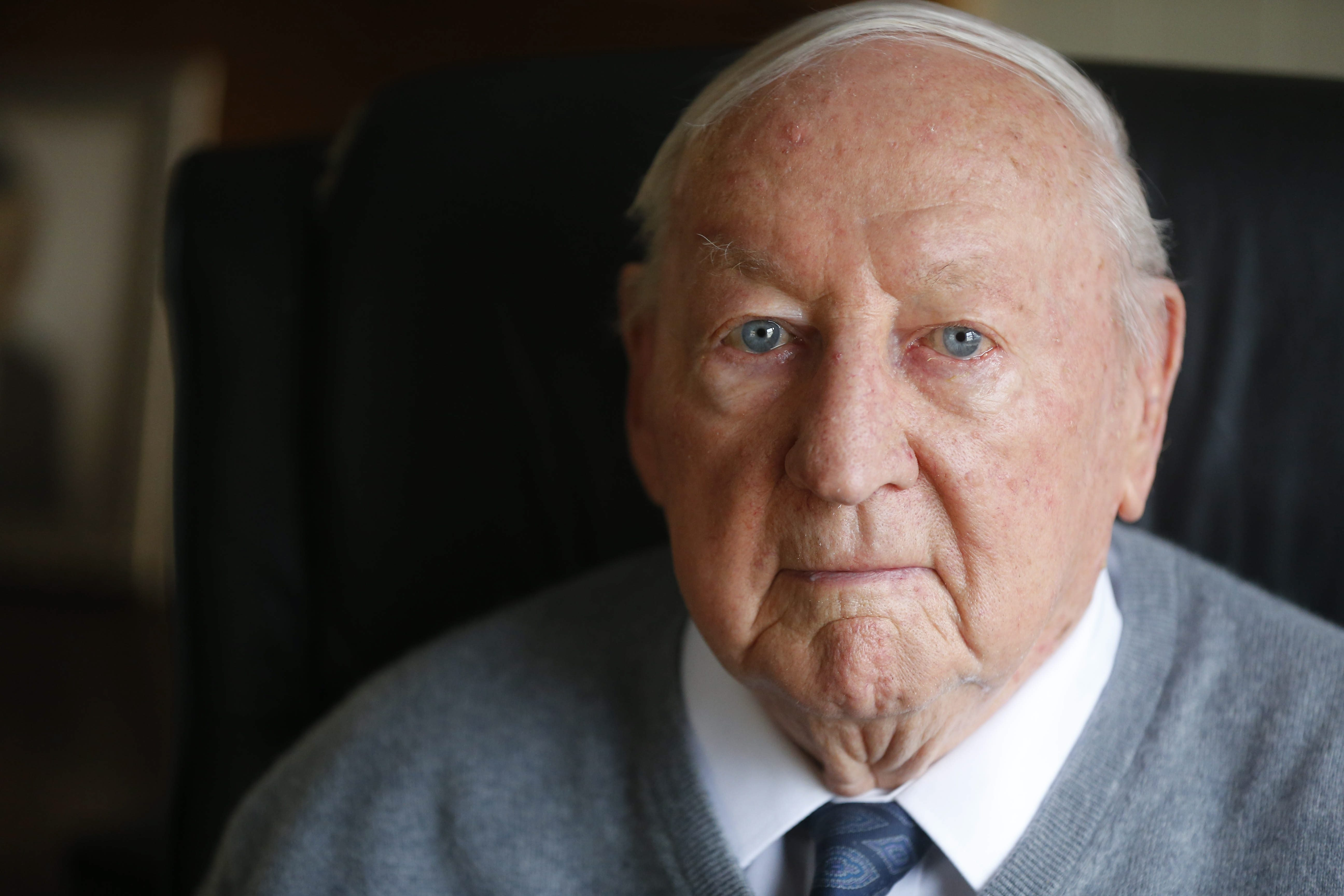 """Bill Young, wounded in the Battle of the Bulge, required """"about 36 penicillin shots to stop infection."""" After the war, he and his brother formed a homebuilding business."""