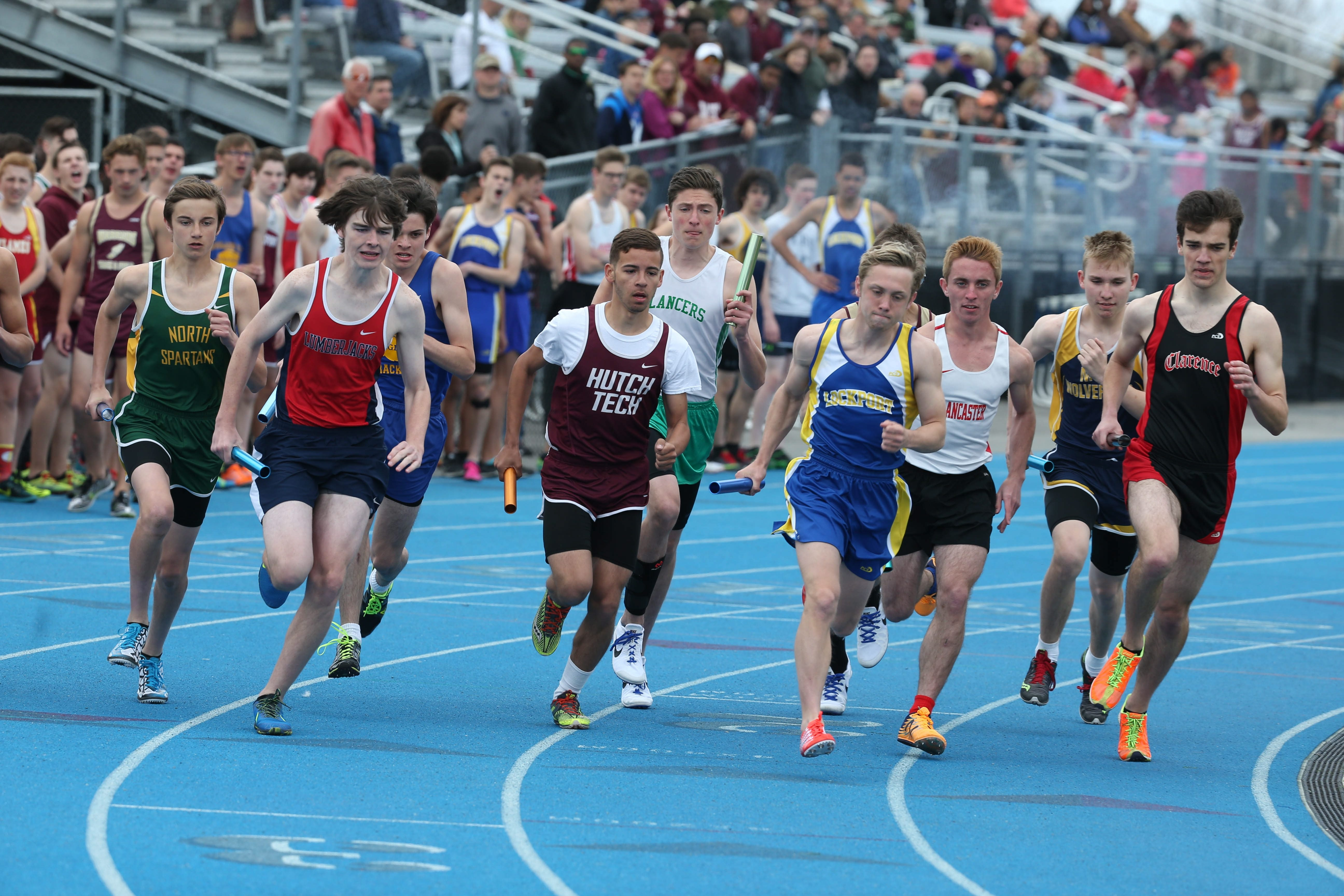 Runners round a turn during action at the Wildcat Relays on Saturday at Depew High School.