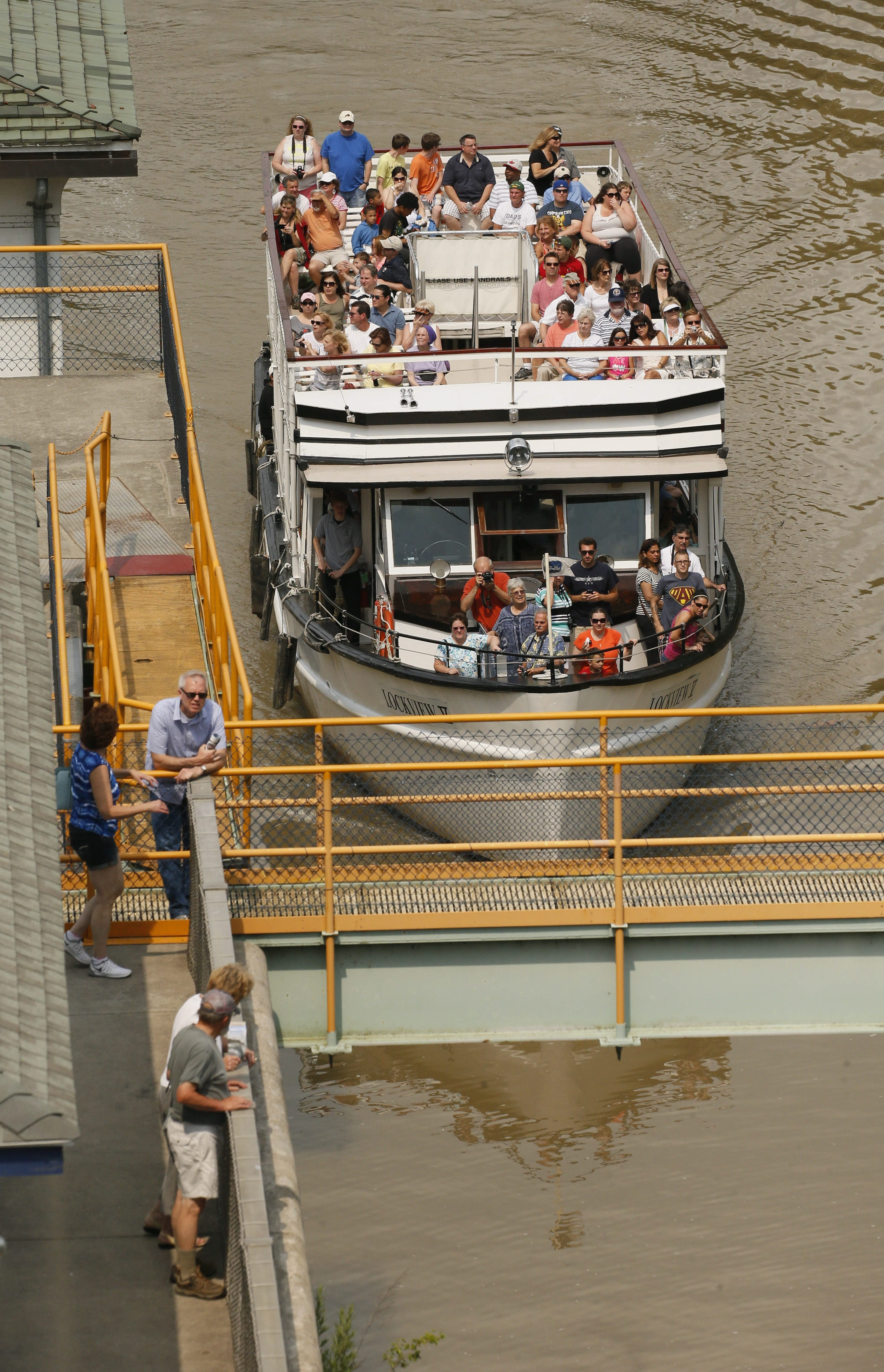 Erie Canal Cruises Lockview V enters a lock during last year's cruising season, when the company's three boats carried about 40,000 people through the Erie Canal locks. This year's season begins on Saturday.