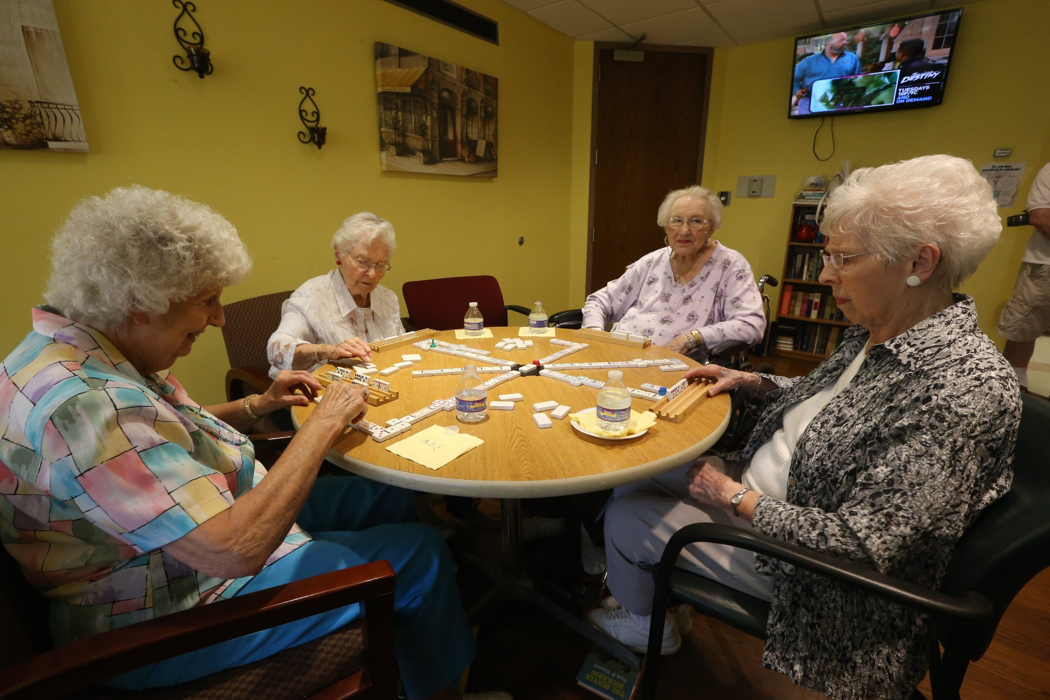 "The four remaining members of ""Phi Di Si,"" a so-called sorority in North Tonawanda that was started in 1946 by a group of friends and classmates 70 years ago clockwise from left, Gloria Jackson,Jean Walters, Dorothy Curtis and Betty Zuch play dominos at their monthly meetings in North Tonawanda, N.Y., on Saturday May 28,2016.  (John Hickey/Buffalo News)"