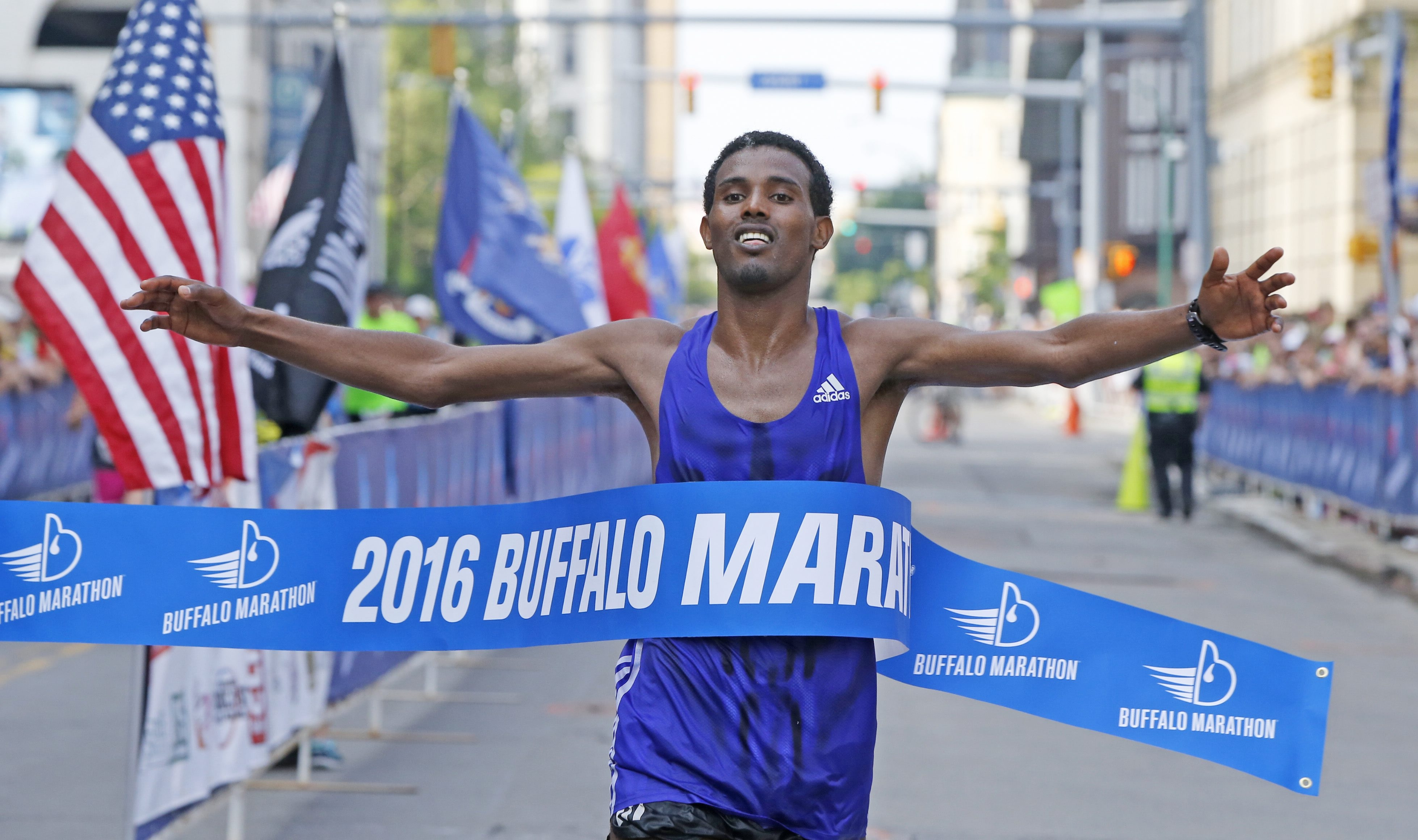 Running his first Buffalo Marathon, Senbeto Geneti Guteta of Ethiopia crosses the finish line with a time of 2 hours, 22 minutes, 50 seconds.