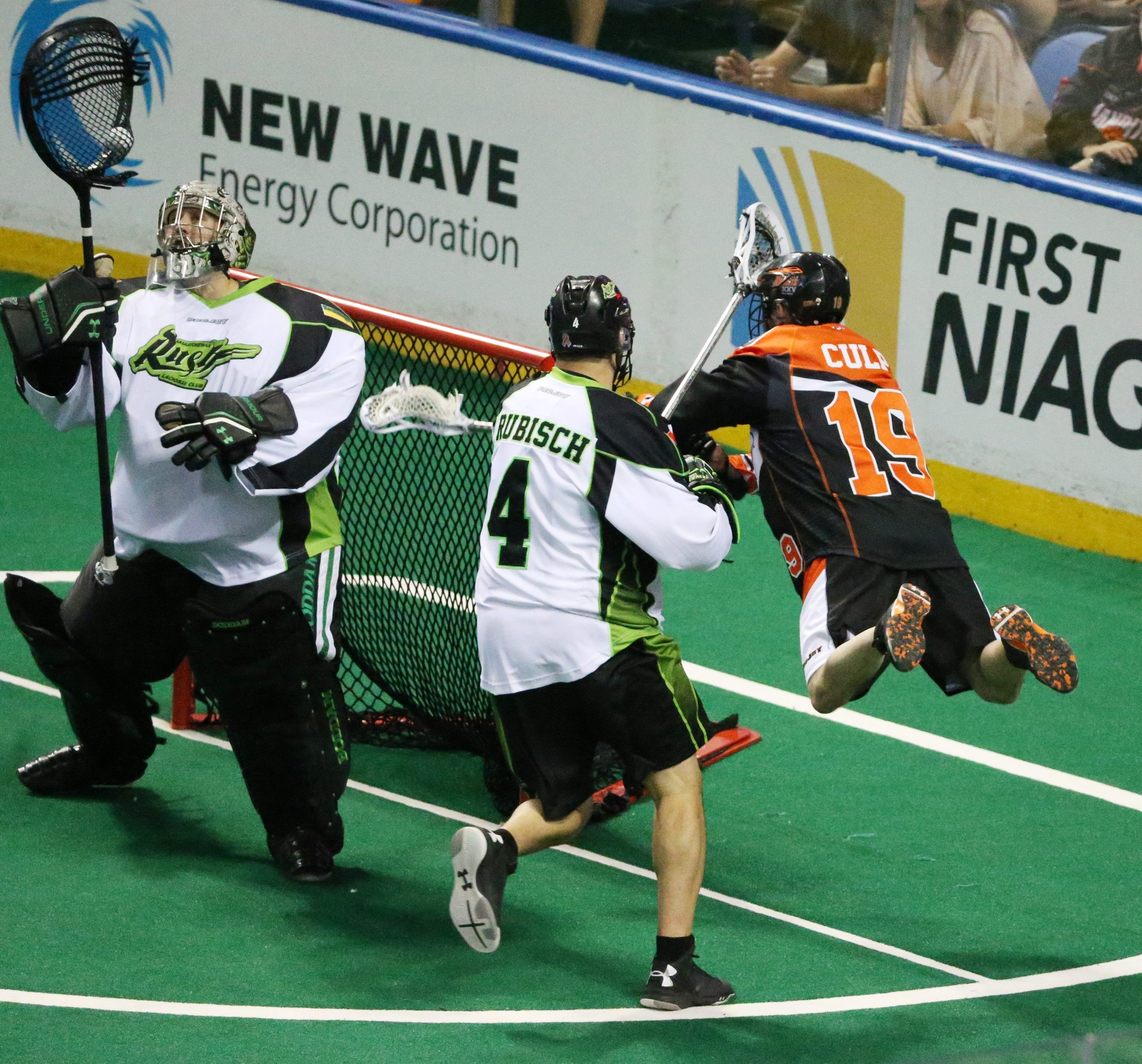 Buffalo's Chad Culp takes flight while shooting on Saskatchewan goalie Aaron Bold in the first game of the NLL finals Saturday.