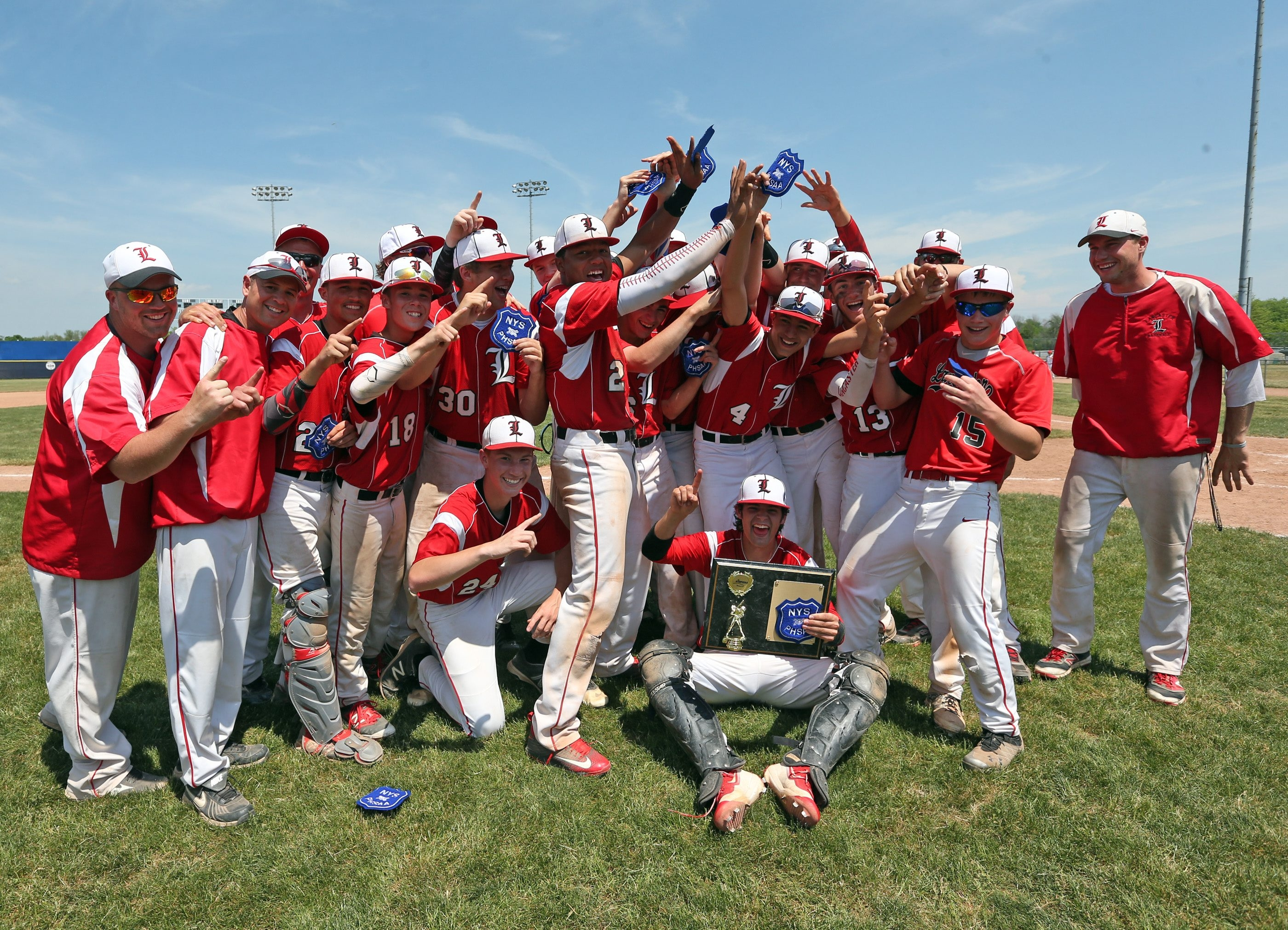 Lancaster celebrates the Section VI Class AA championship after beating Niagara Falls on Saturday at Sal Maglie Stadium.