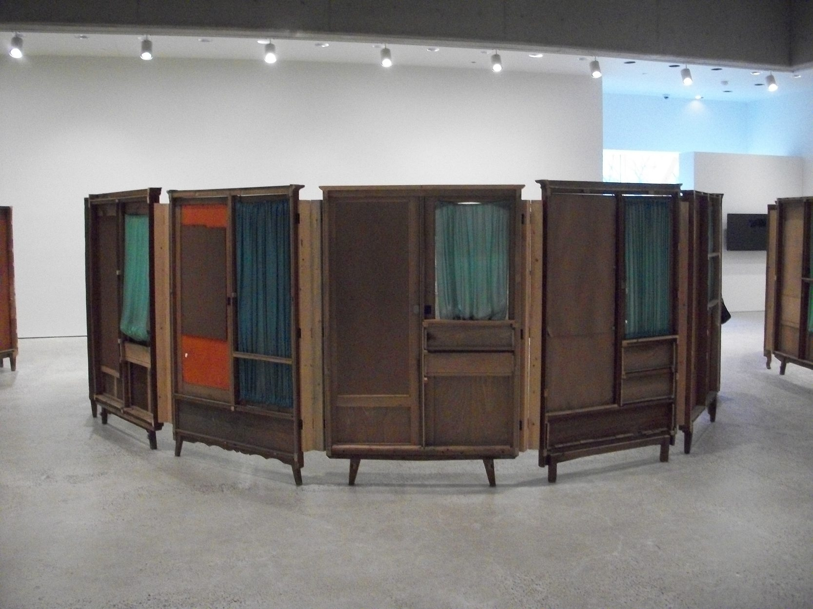 """Vintage wardrobe doors from Song Dong's """"Communal Courtyard"""" exhibit at the Art Gallery of Ontario."""