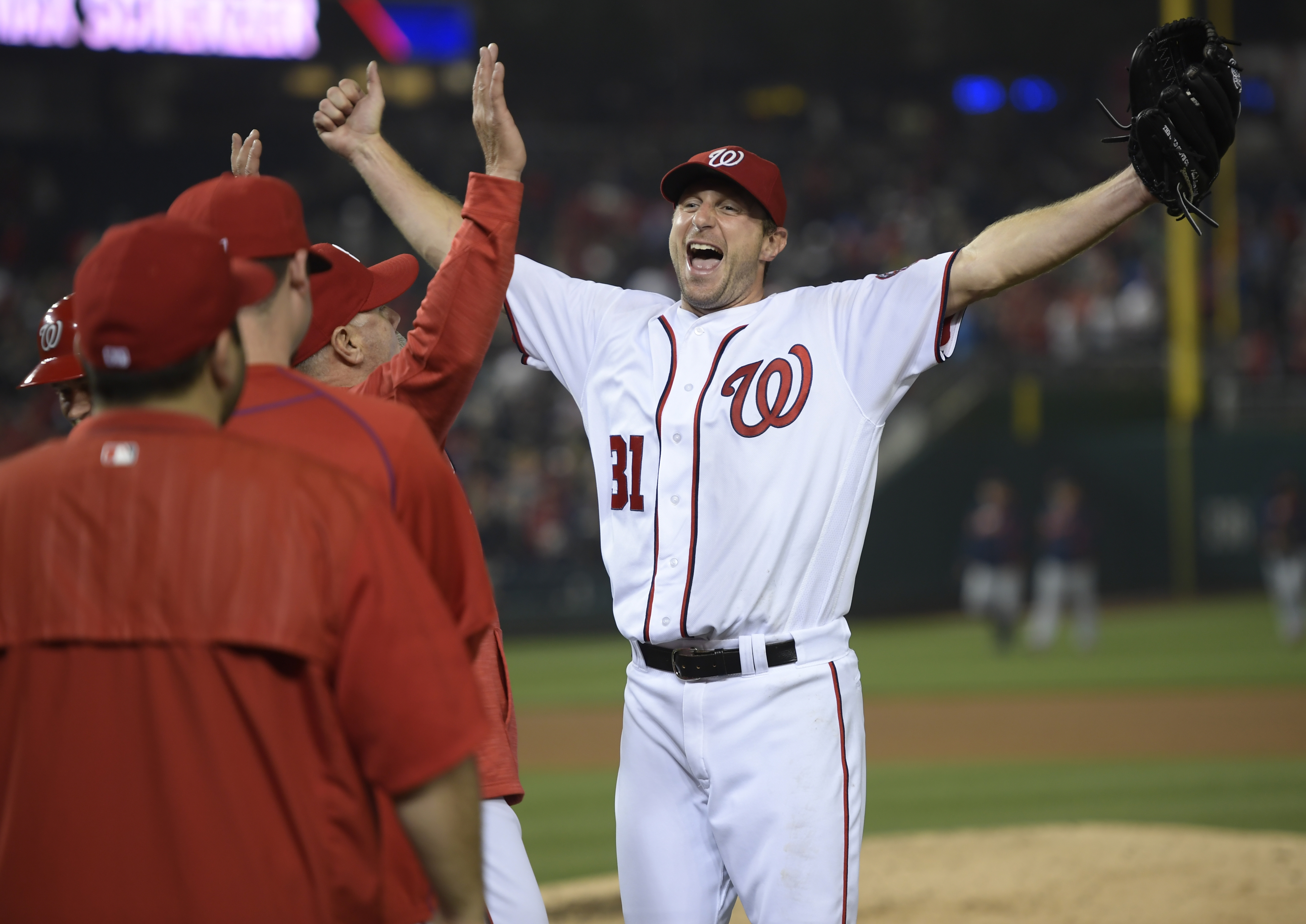 Nationals starting pitcher Max Scherzer rejoices after finishing off the Tigers on Wednesday night thanks in part to his 20 strikeouts.