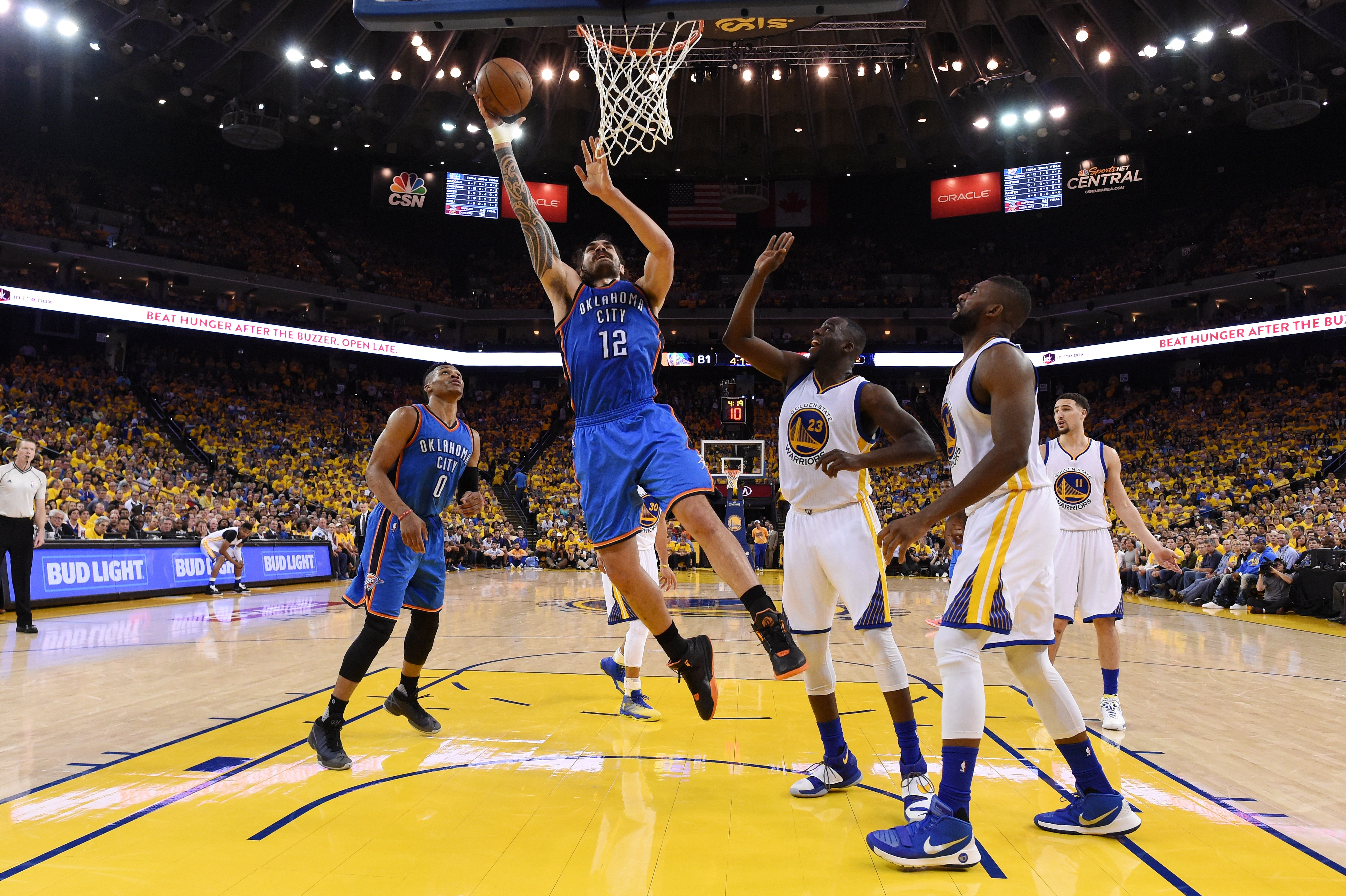 Steven Adams (12) of the Oklahoma City Thunder goes up for a shot against the Golden State Warriors during Game Two of the Western Conference NBA Finals at ORACLE Arena in Oakland, California. (Photo by Thearon W. Henderson/Getty Images)