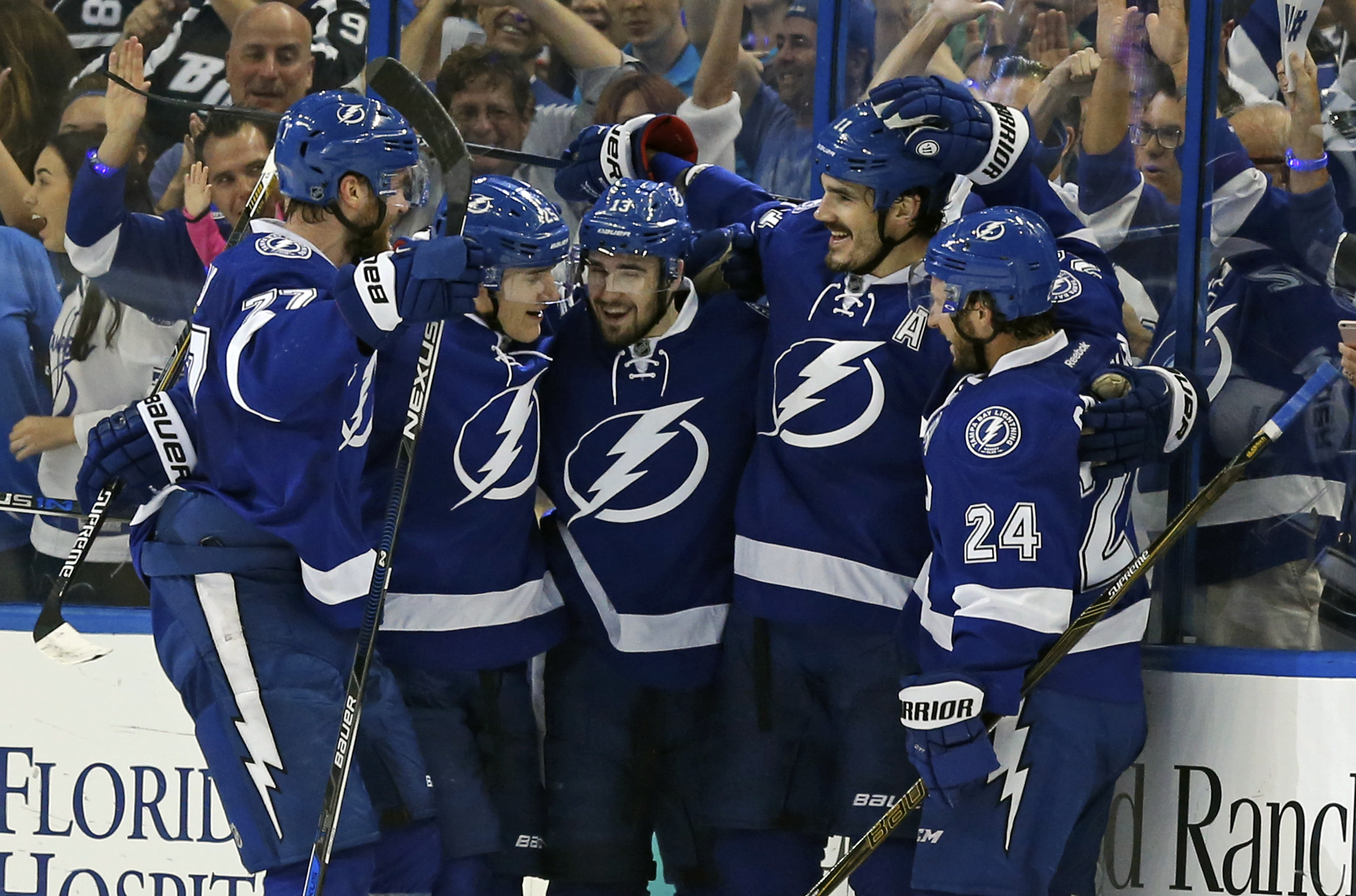 Victor Hedman (77), Matt Carle (25), Cedric Paquette (13) and Ryan Callahan (24) celebrate a goal by Brian Boyle (11) during Tampa Bay's series-clinching win. (Getty Images)