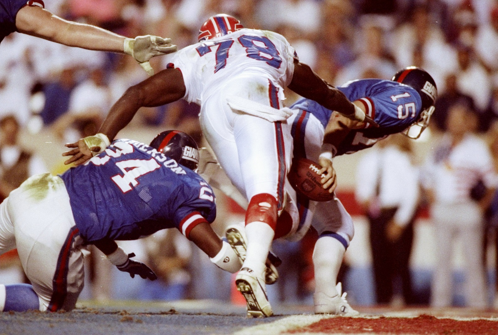 Bruce Smith nearly ripped the ball loose from Giants QB Jeff Hostetler in Super Bowl XXV. (Getty Images)